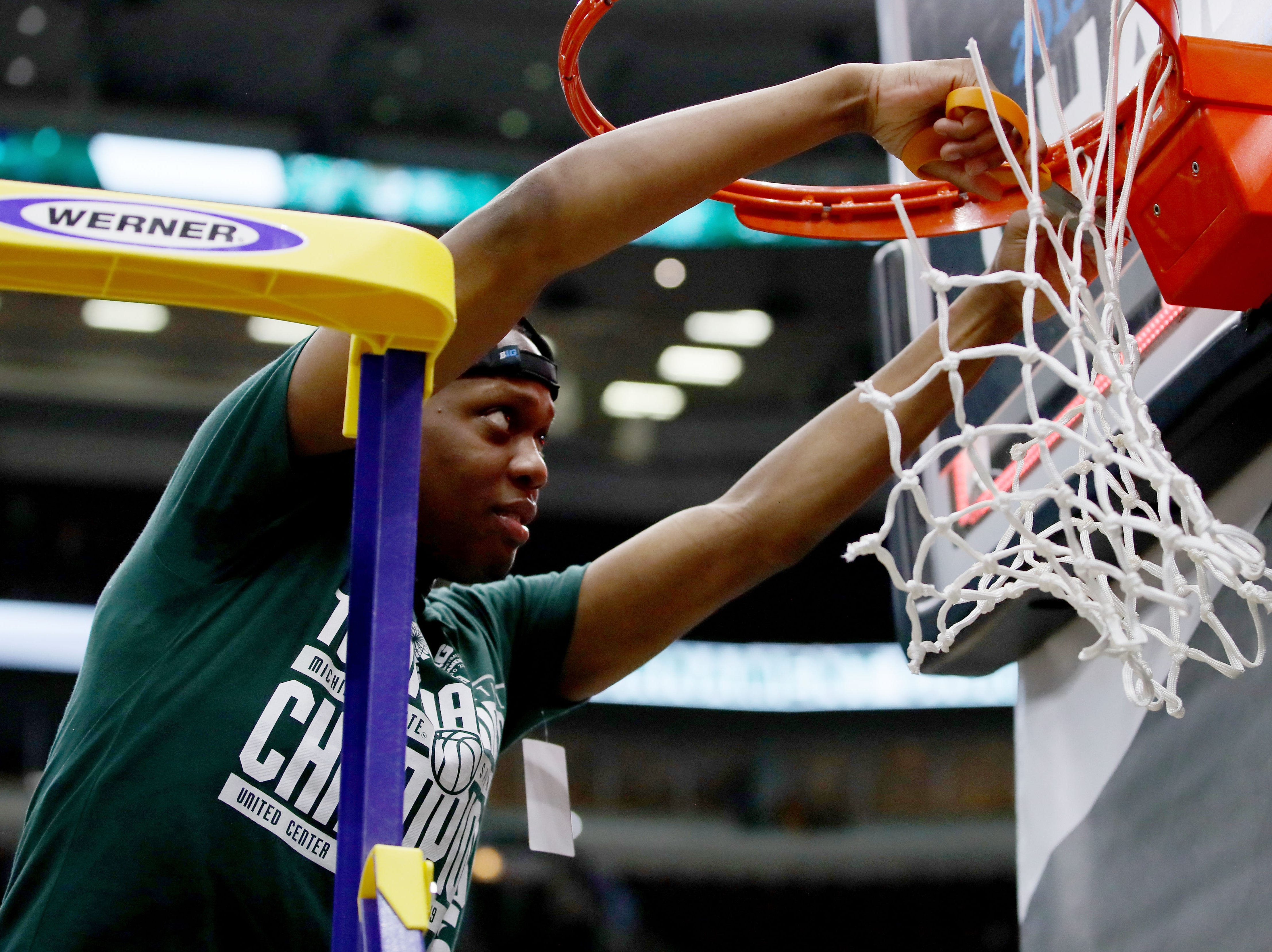 CHICAGO, ILLINOIS - MARCH 17:  Cassius Winston #5 of the Michigan State Spartans cuts down the nets after beating the Michigan Wolverines 65-60 in the championship game of the Big Ten Basketball Tournament at the United Center on March 17, 2019 in Chicago, Illinois. (Photo by Jonathan Daniel/Getty Images)
