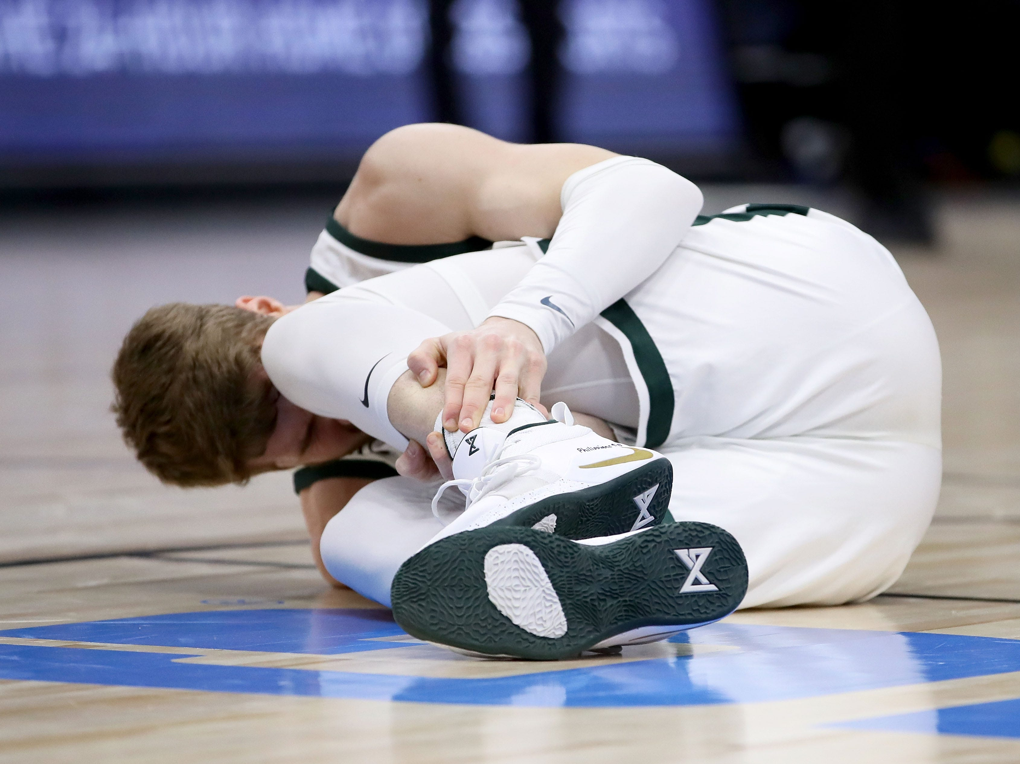 CHICAGO, ILLINOIS - MARCH 17:  Kyle Ahrens #0 of the Michigan State Spartans reacts after being injured in the first half against the Michigan Wolverines during the championship game of the Big Ten Basketball Tournament at the United Center on March 17, 2019 in Chicago, Illinois.