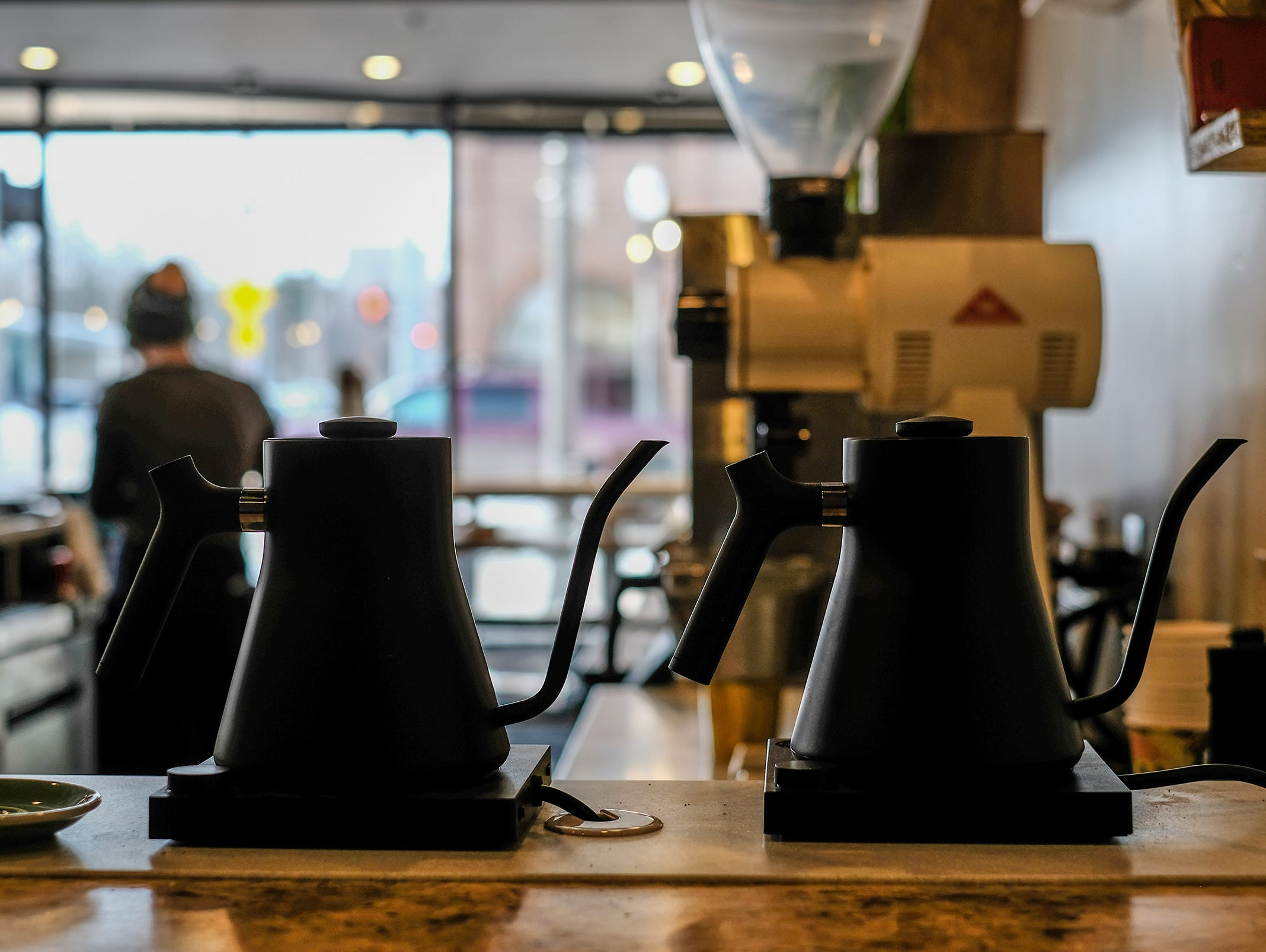 Hot water kettles are ready for a pour-over at Strange Matter Coffee in downtown Lansing.