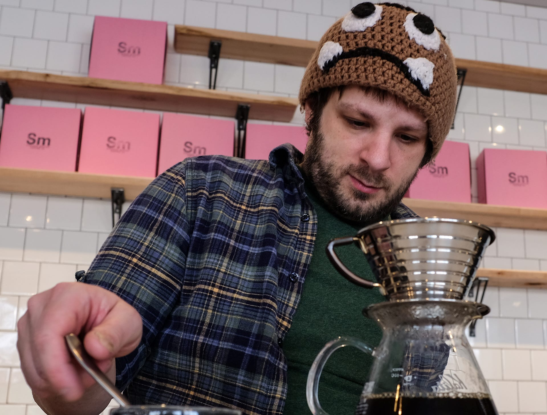 John Rumiez, barista at Strange Matter on Michigan Avenue, makes a pour-over which cost more, take longer to make and use better coffee.