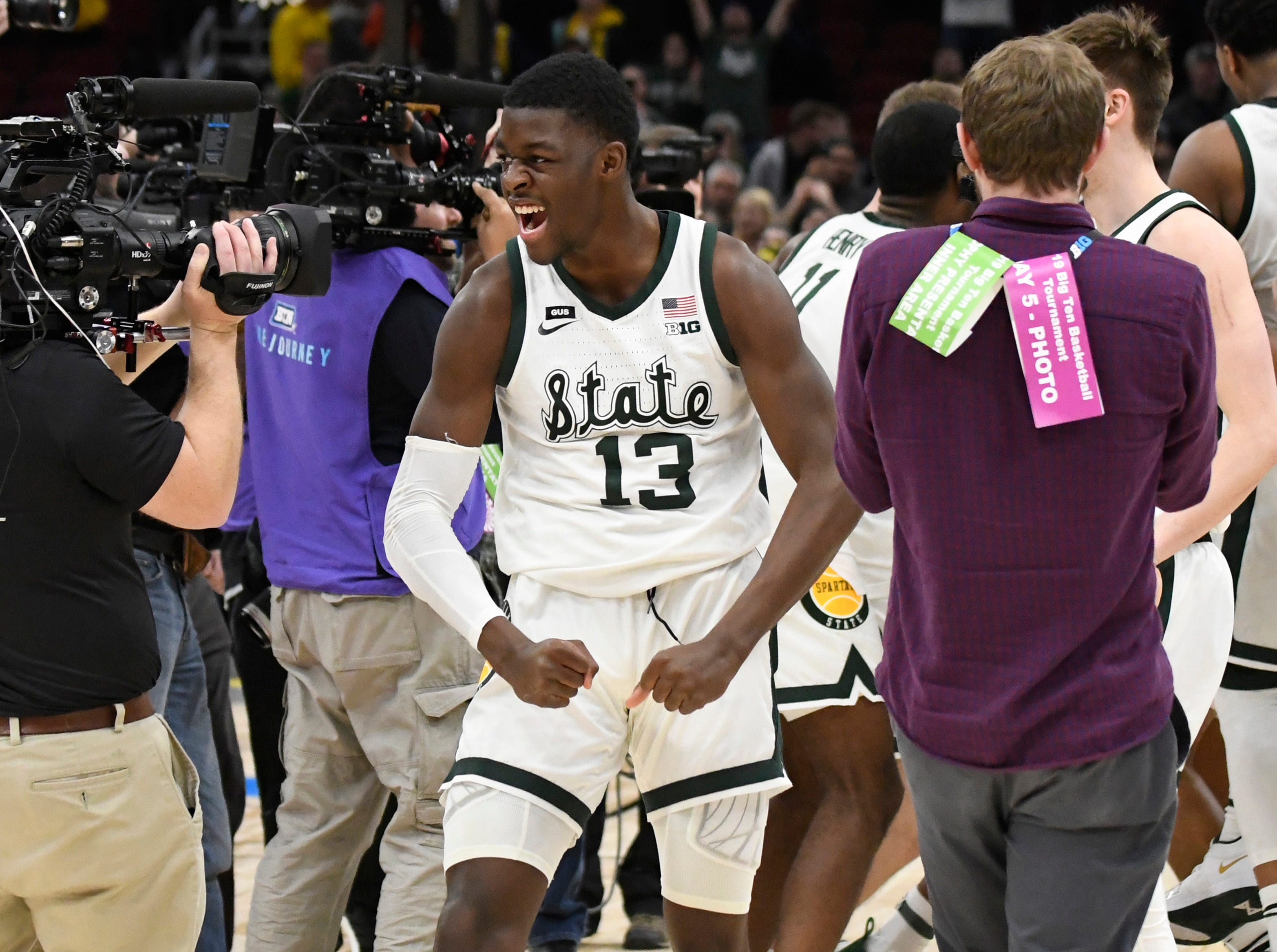 Mar 17, 2019; Chicago, IL, USA; Michigan State Spartans forward Gabe Brown (13) celebrates their championship against the Michigan Wolverines in the Big Ten conference tournament at United Center. Mandatory Credit: David Banks-USA TODAY Sports