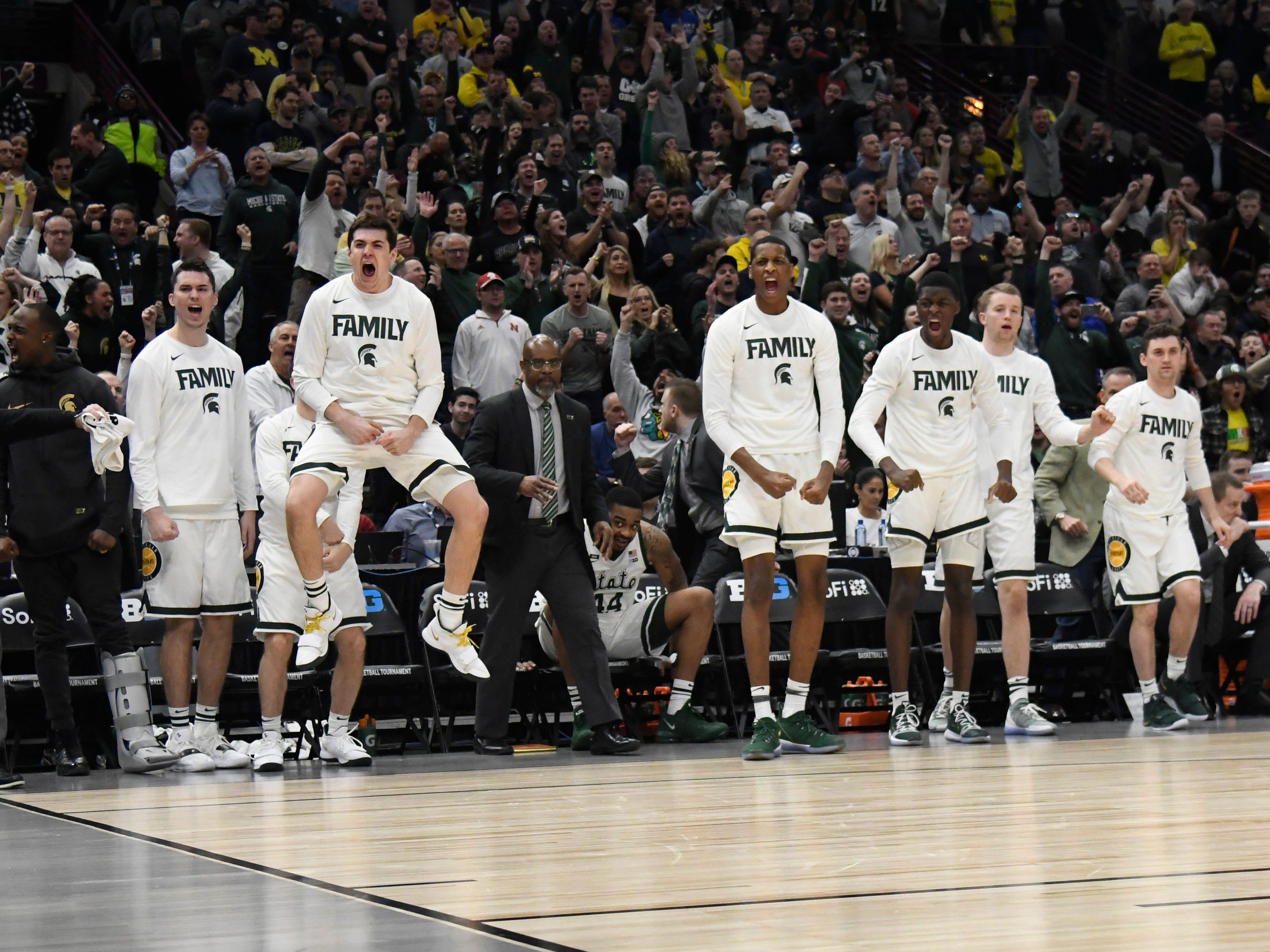 Mar 17, 2019; Chicago, IL, USA; The Michigan State Spartans bench celebrate a basket against the Michigan Wolverines during the second half in the Big Ten conference tournament at United Center. Mandatory Credit: David Banks-USA TODAY Sports