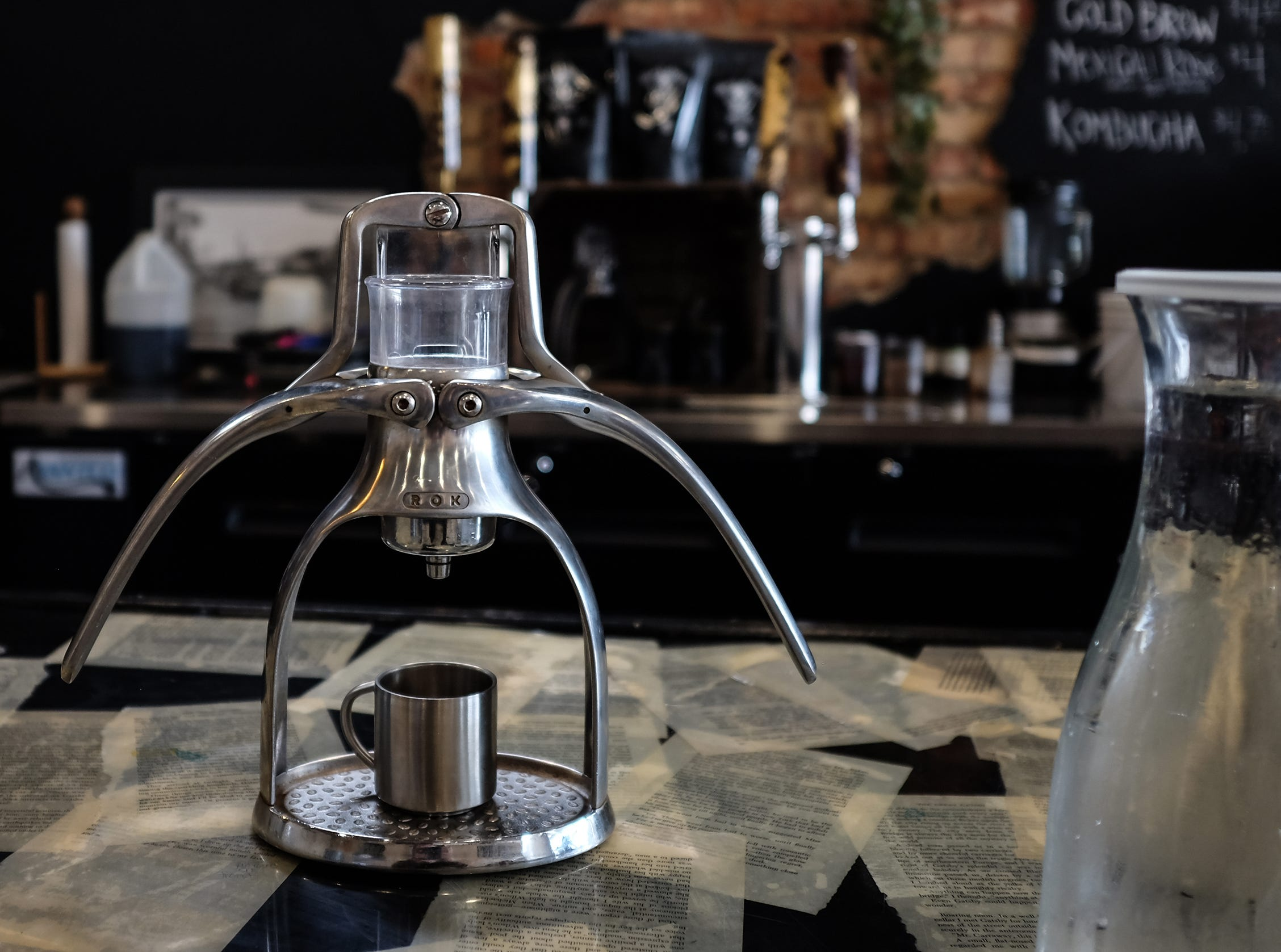 A hand operated expresso coffee press at The Crafted Bean in Lansing is on display.