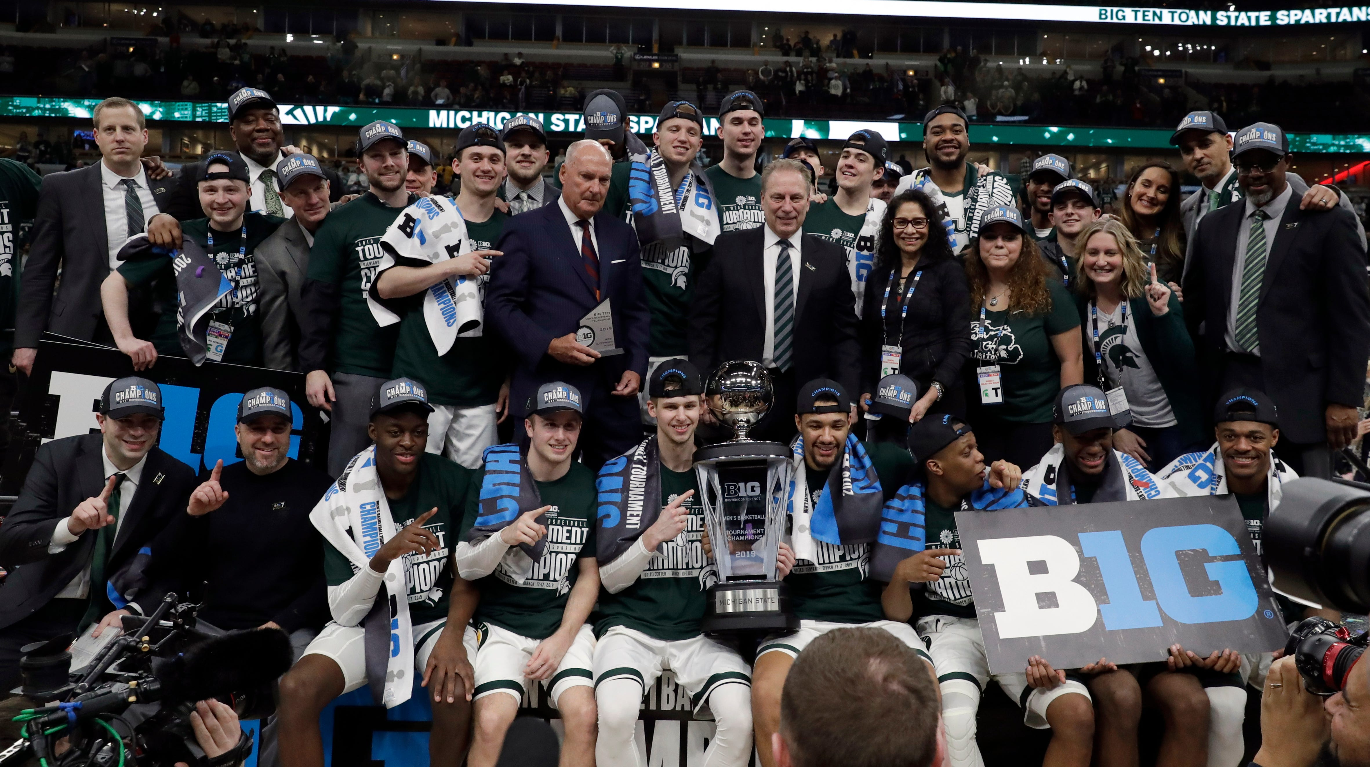 Michigan State players and coaches pose with the...