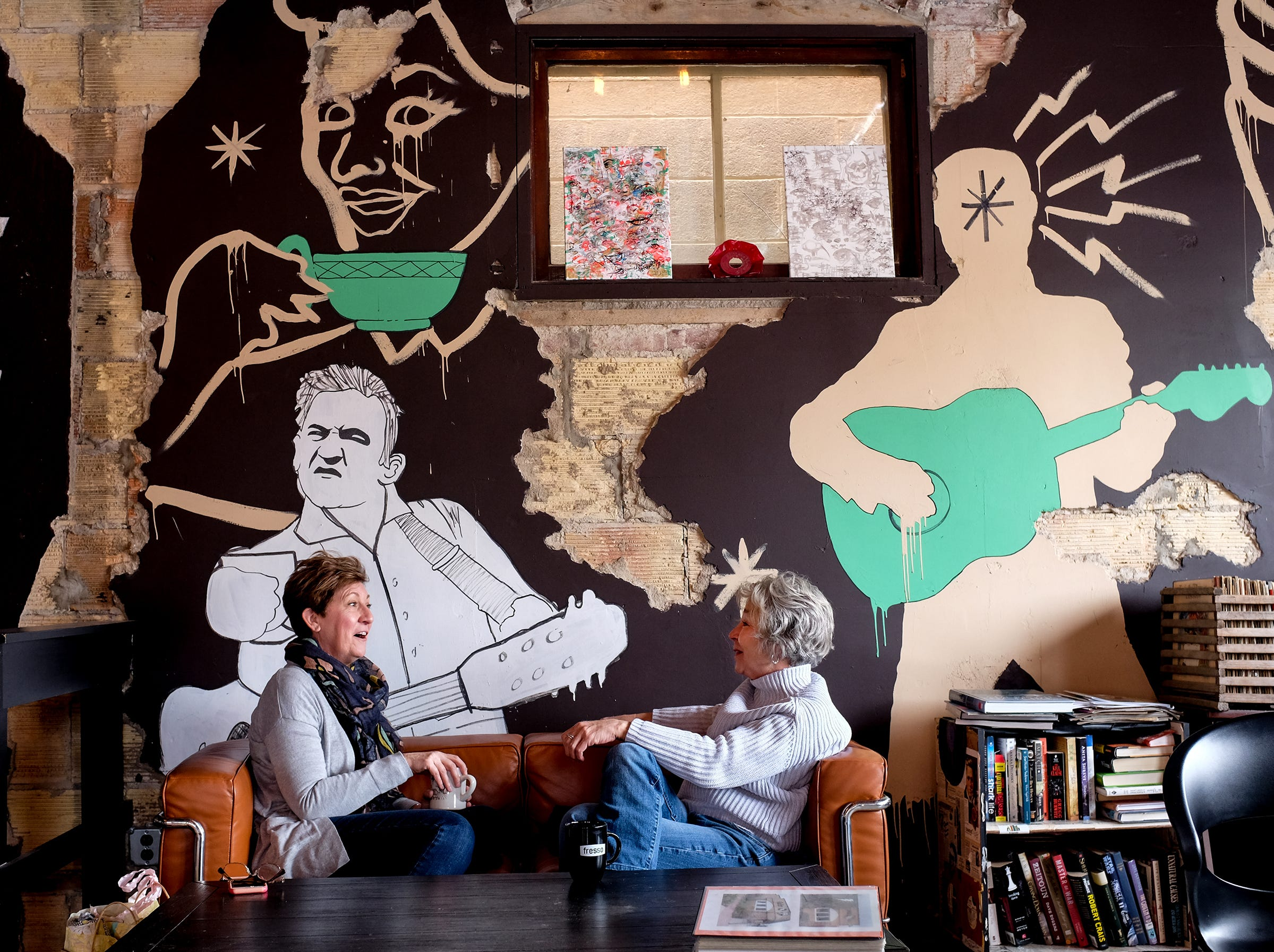 Loralee Schultz, left, from Grand Ledge and sister-in-law Jean Schultz from East Lansing have a conversation at The Crafted Bean in DeWitt.