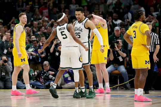 Kenny Goins, right, is the only MSU player to have been on one of the Spartans' Final Four teams. Goins and Cassius Winston, left, have learned from recent NCAA tournament mishaps.