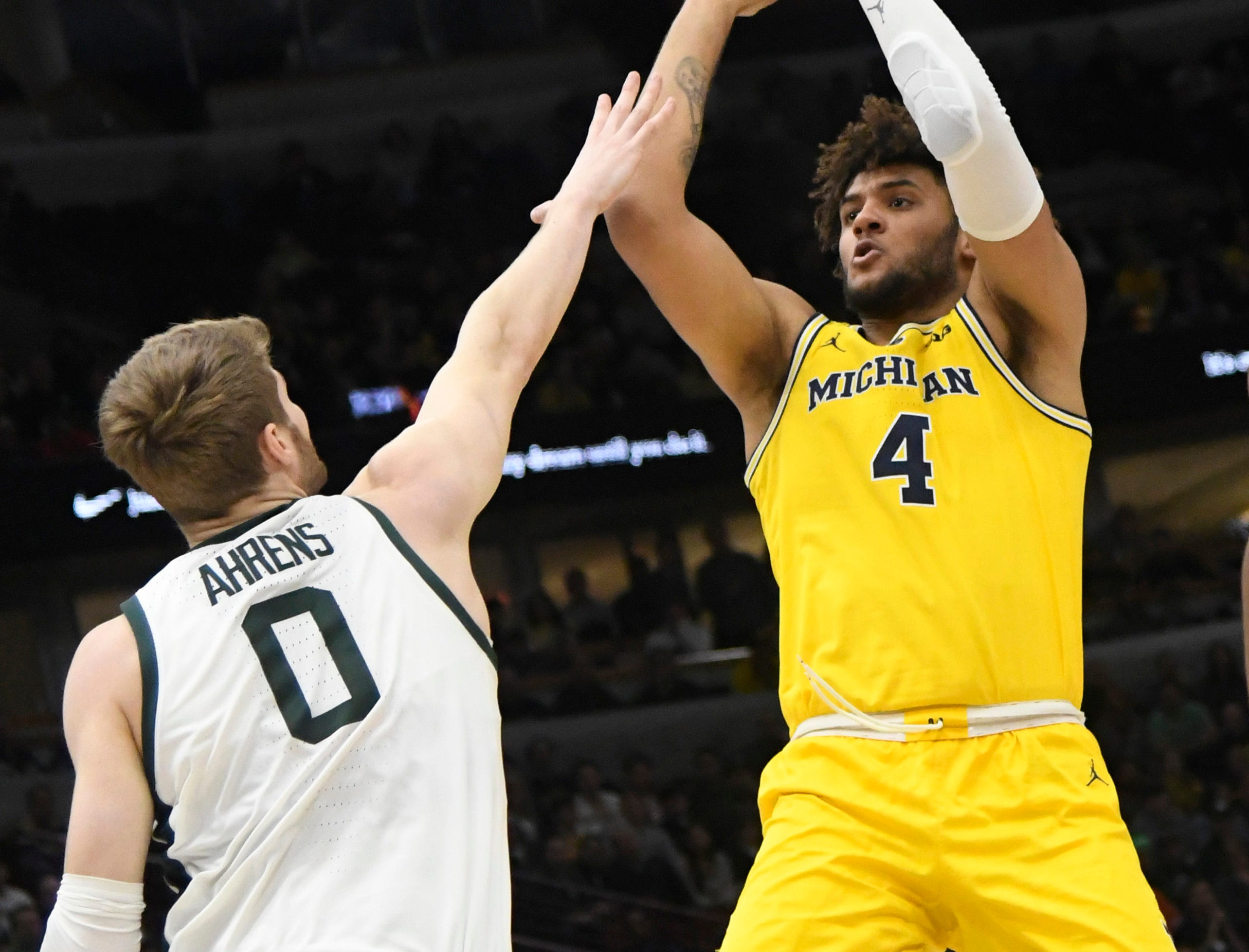 Michigan Wolverines forward Isaiah Livers (4) shoots over Michigan State Spartans forward Kyle Arenas (0) during the first half in the Big Ten conference tournament at United Center.