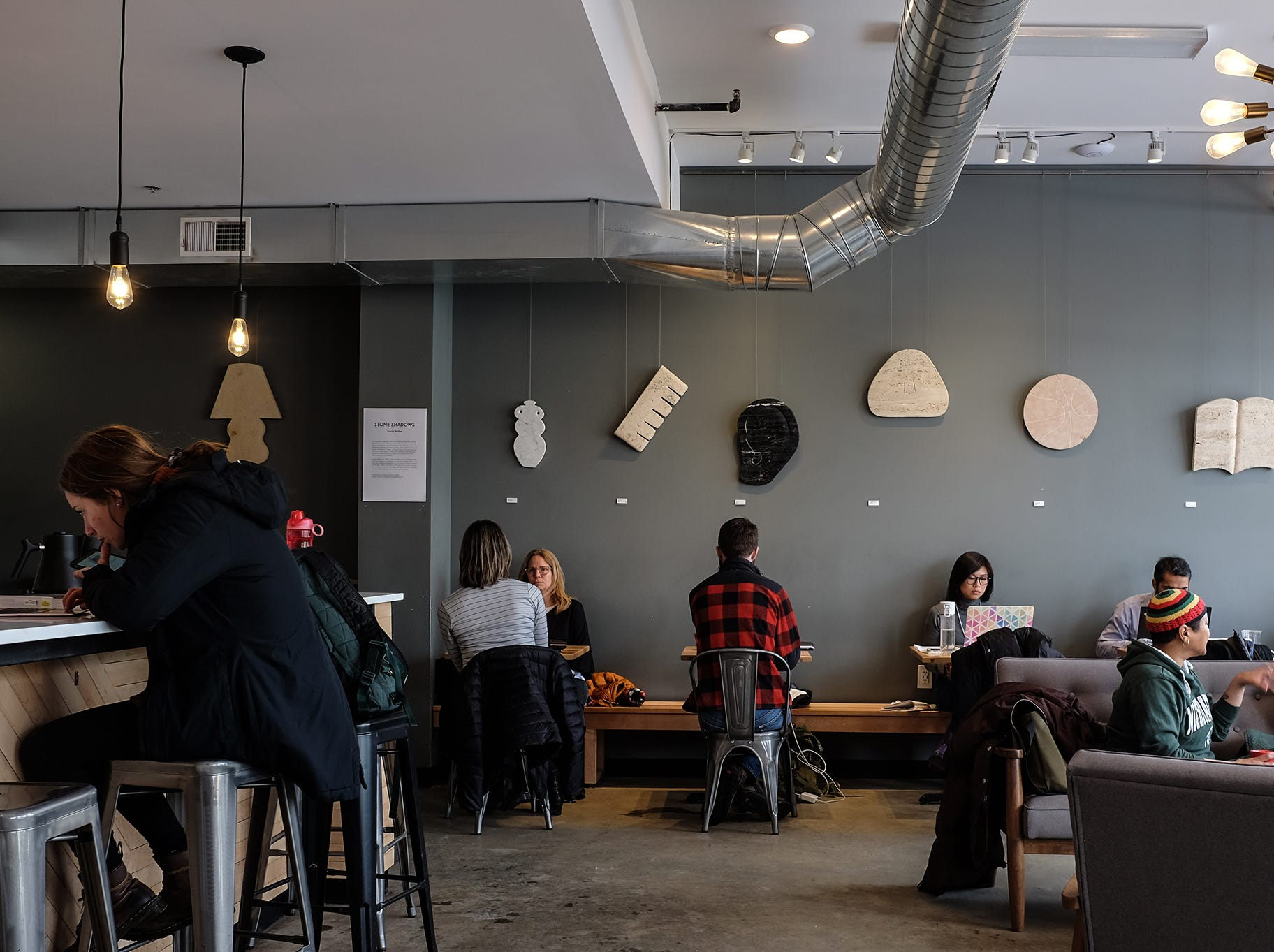 People relax, work, and have conversations at Strange Matter Coffee on Michigan Avenue.
