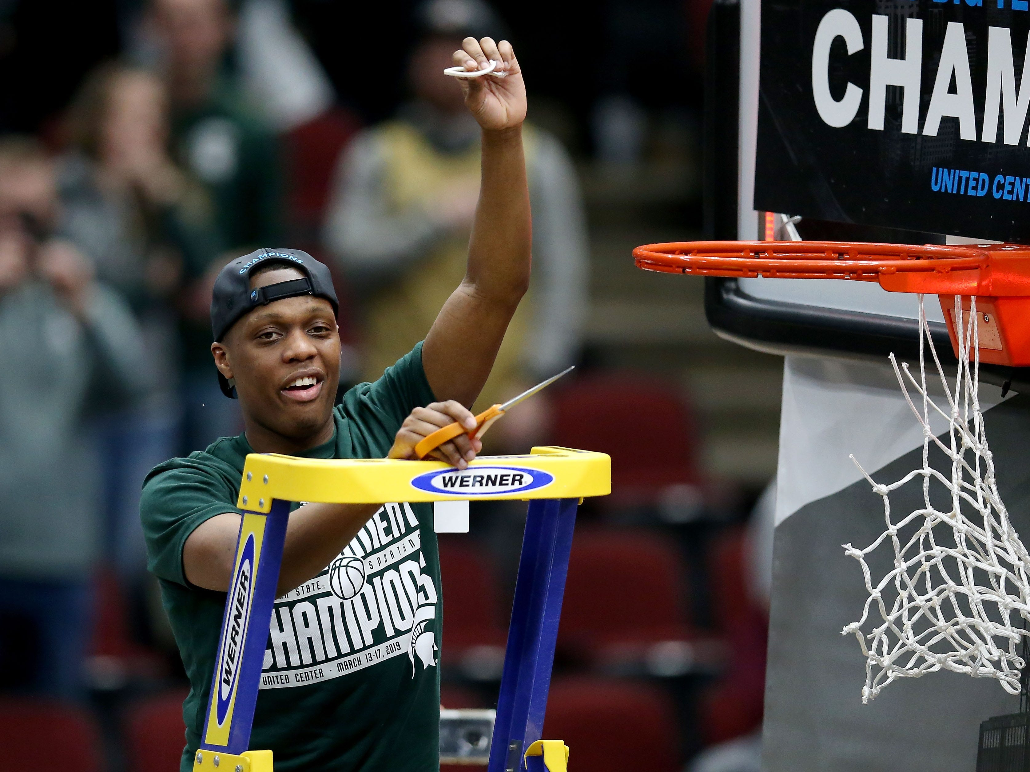 CHICAGO, ILLINOIS - MARCH 17:  Cassius Winston #5 of the Michigan State Spartans cuts down the net after beating the Michigan Wolverines 65-60 in the championship game of the Big Ten Basketball Tournament at the United Center on March 17, 2019 in Chicago, Illinois. (Photo by Dylan Buell/Getty Images)