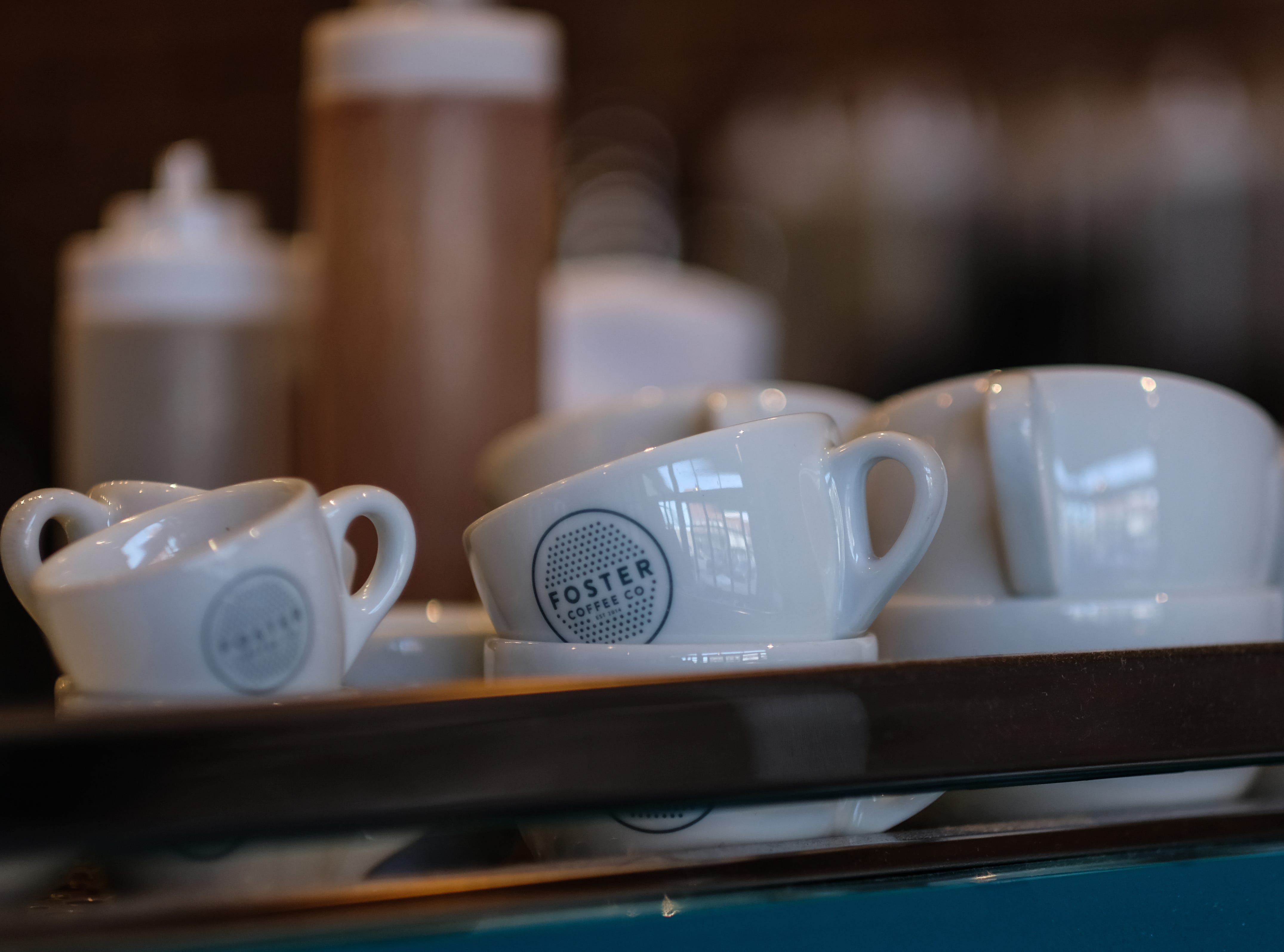 Cups of various sizes are ready for use at Foster Coffee Company in Owosso.