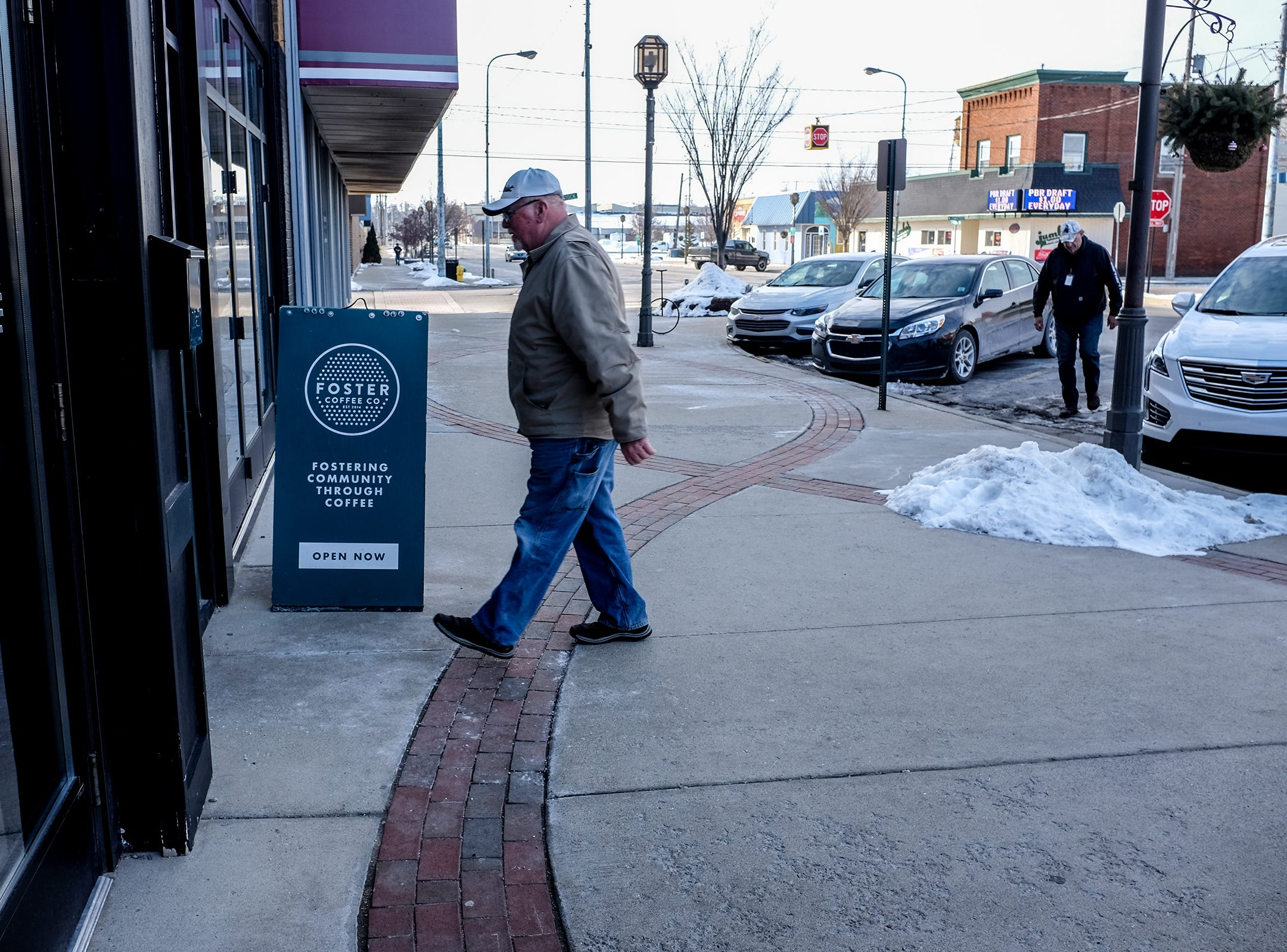 A steady stream of customers go into Foster Coffee Company in Owosso in the mornings. The craft coffee shop opened in 2014.