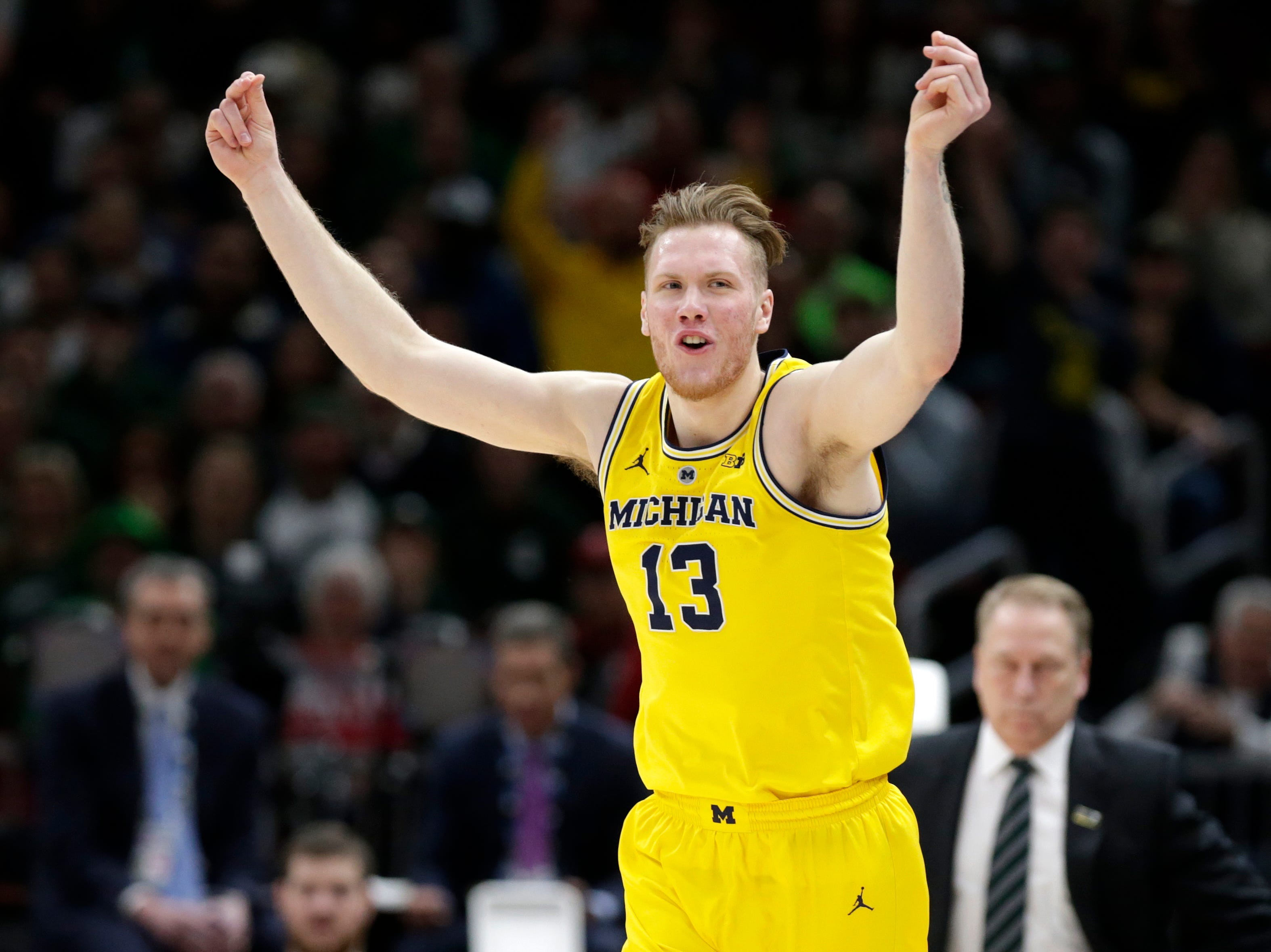 Michigan's Ignas Brazdeikis (13) reacts after shooting a 3-point basket during the first half of an NCAA college basketball championship game against Michigan State in the Big Ten Conference tournament, Sunday, March 17, 2019, in Chicago.