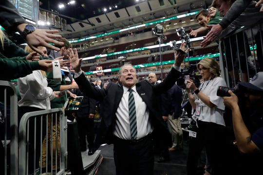 Michigan State head coach Tom Izzo thanks fans as he walks off after defeating Michigan 65-60 in an NCAA college basketball championship game in the Big Ten Conference tournament, Sunday, March 17, 2019, in Chicago. (AP Photo/Nam Y. Huh)