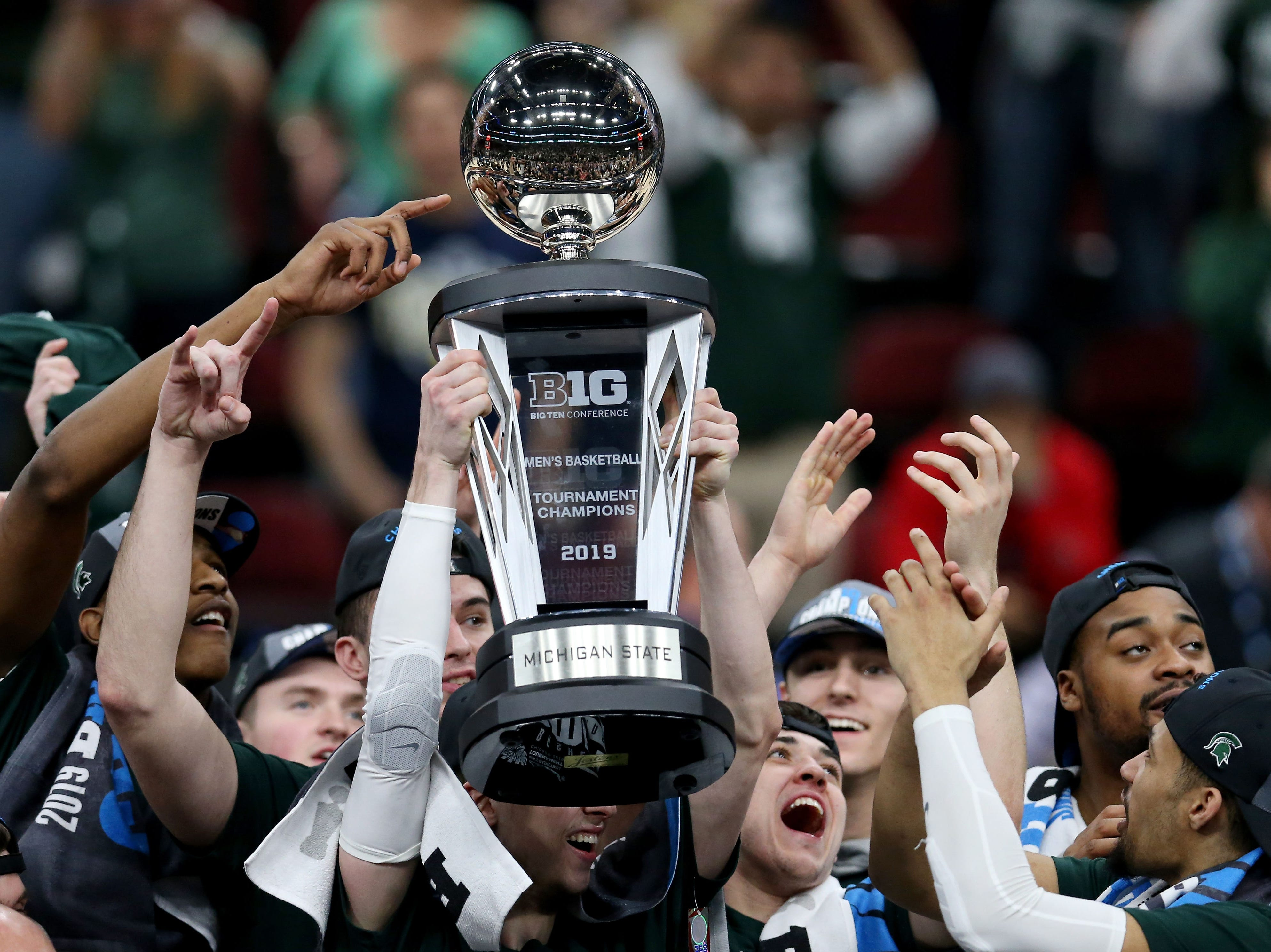 CHICAGO, ILLINOIS - MARCH 17:  The Michigan State Spartans celebrate after beating the Michigan Wolverines 65-60 in the championship game of the Big Ten Basketball Tournament at the United Center on March 17, 2019 in Chicago, Illinois. (Photo by Dylan Buell/Getty Images)