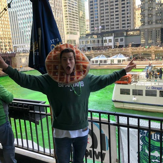 "Nathan ""Waffle Guy"" Guzowski, 22, is a Michigan State University student who celebrated his alma mater's Big Ten Tournament title in Chicago over the weekend."