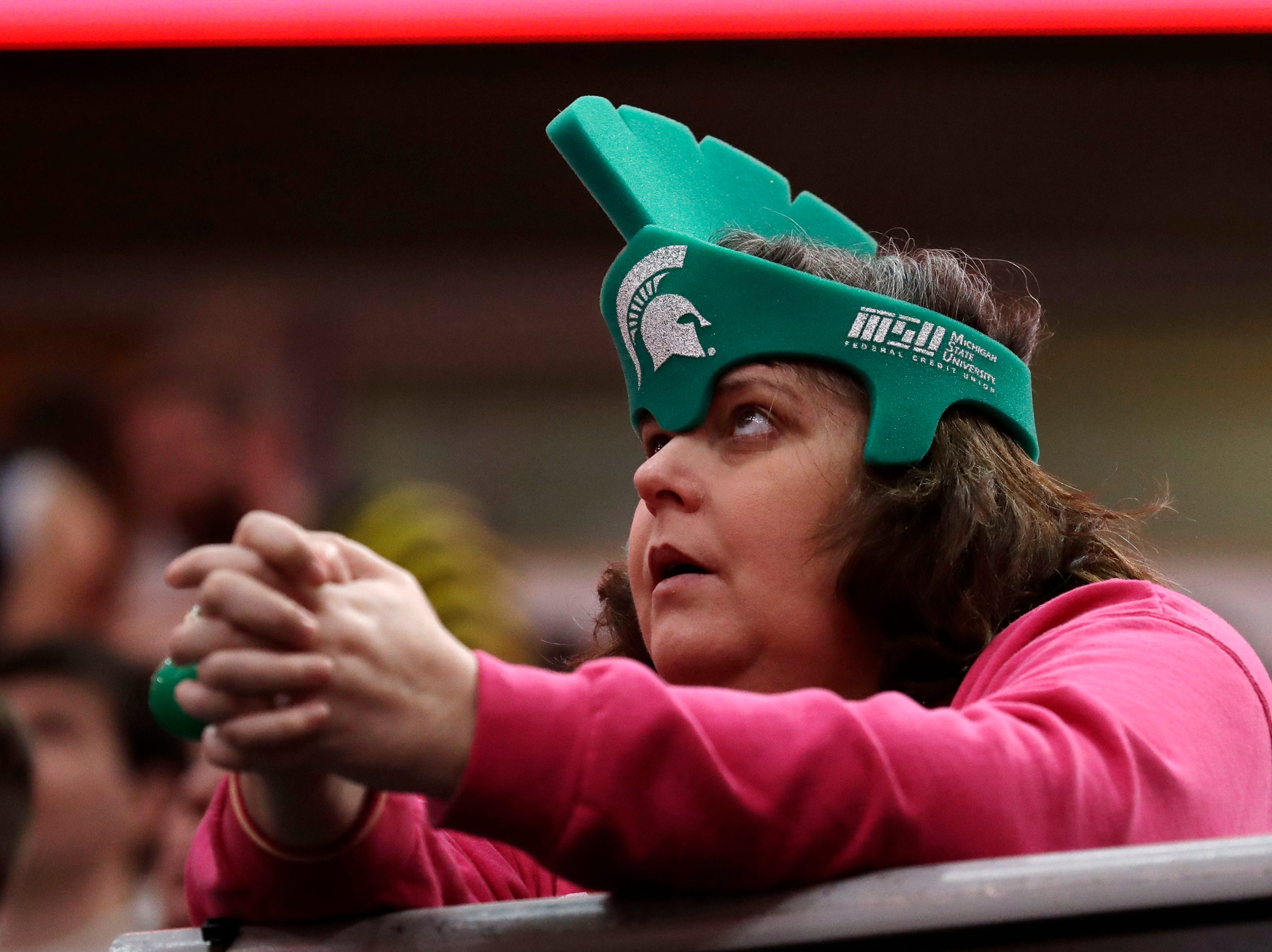 A Michigan State fan waits for an NCAA college basketball championship game between the Michigan State and the Michigan in the Big Ten Conference tournament, Sunday, March 17, 2019, in Chicago.