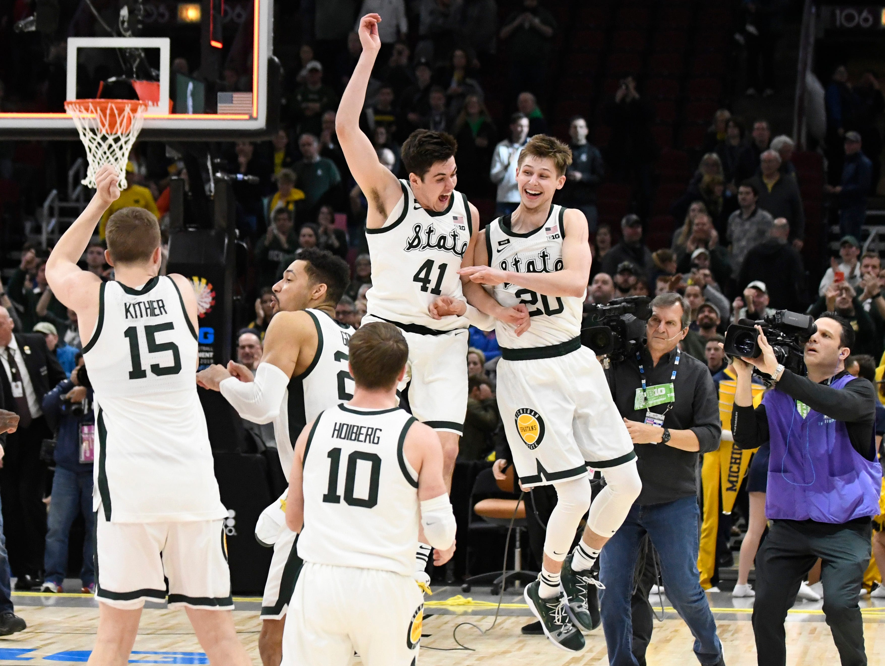 Mar 17, 2019; Chicago, IL, USA; Michigan State Spartans guard Matt McQuaid (20) and guard Conner George (41) celebrate their championship against the Michigan Wolverines in the Big Ten conference tournament at United Center. Mandatory Credit: David Banks-USA TODAY Sports