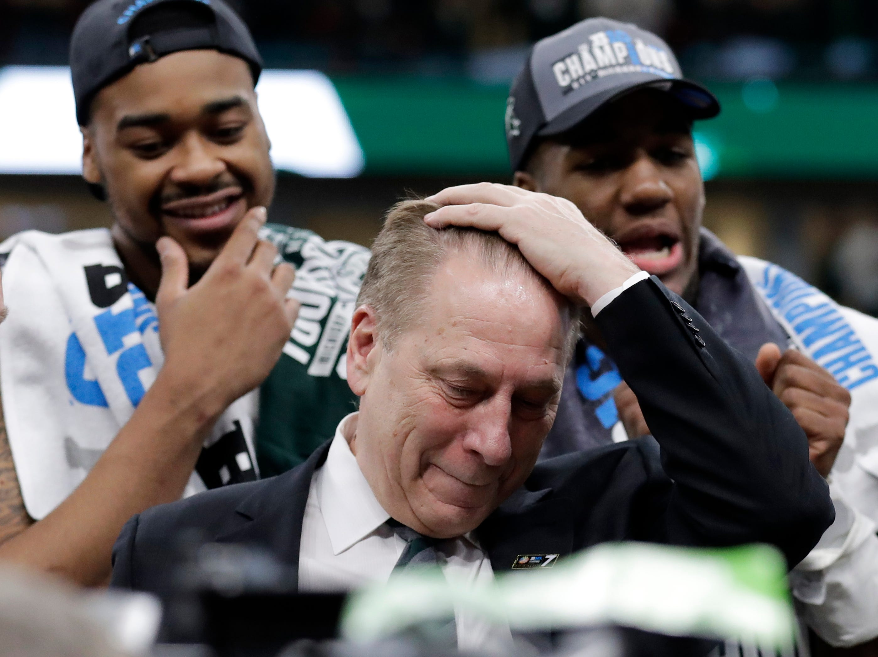 Michigan State head coach Tom Izzo celebrates with his team after defeating Michigan 65-60 in an NCAA college basketball championship game in the Big Ten Conference tournament, Sunday, March 17, 2019, in Chicago.
