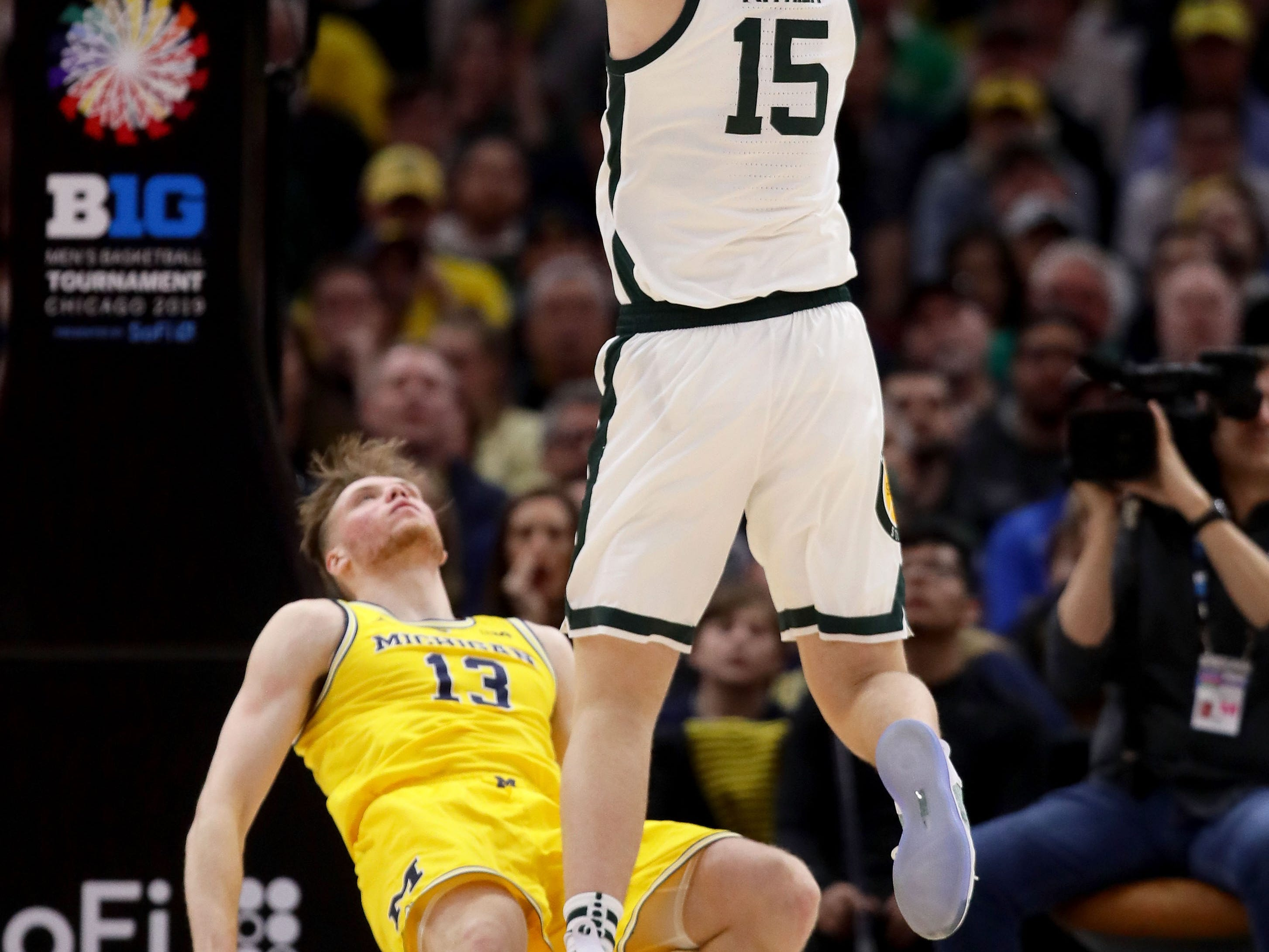 Thomas Kithier #15 of the Michigan State Spartans attempts a shot over Ignas Brazdeikis #13 of the Michigan Wolverines in the first half during the championship game of the Big Ten Basketball Tournament at the United Center on March 17, 2019 in Chicago, Illinois.