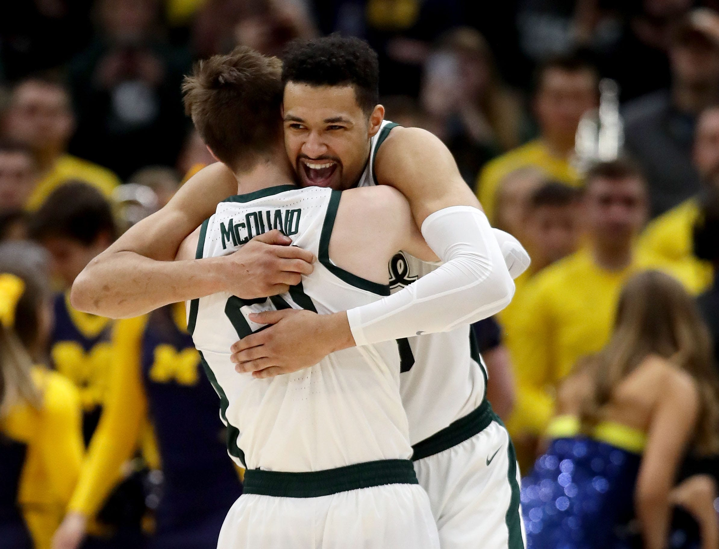 CHICAGO, ILLINOIS - MARCH 17:  Matt McQuaid #20 and Kenny Goins #25 of the Michigan State Spartans celebrate in the second half against the Michigan Wolverines during the championship game of the Big Ten Basketball Tournament at the United Center on March 17, 2019 in Chicago, Illinois. (Photo by Jonathan Daniel/Getty Images)