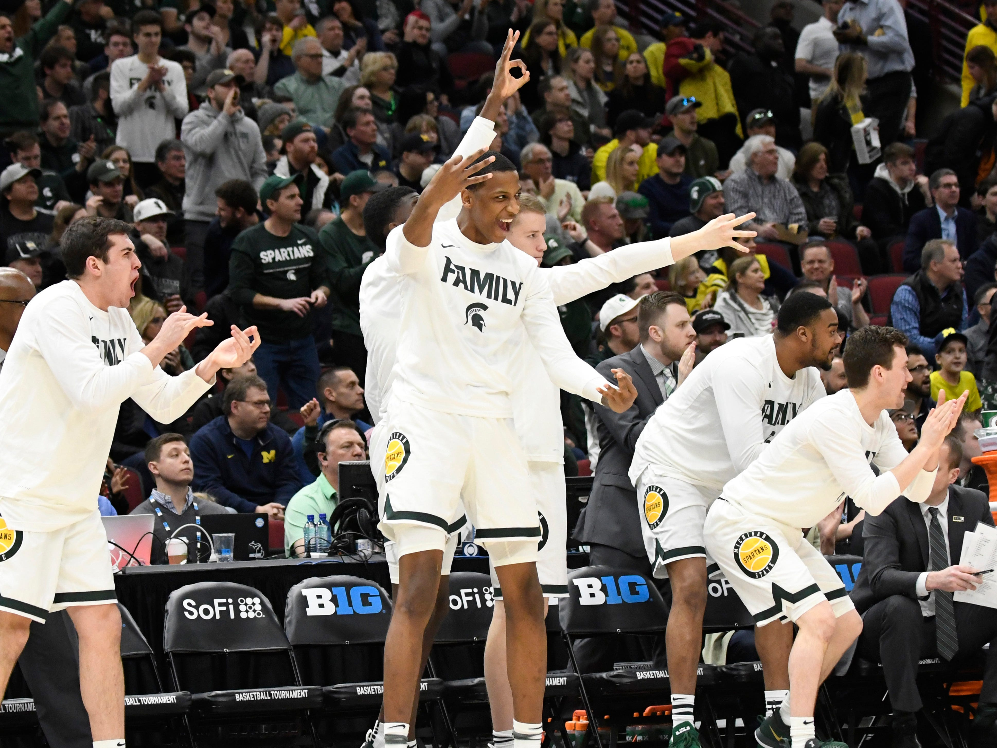 The Michigan State Spartans bech celebrate a three-point basket against the Michigan Wolverines during the first half in the Big Ten conference tournament at United Center.