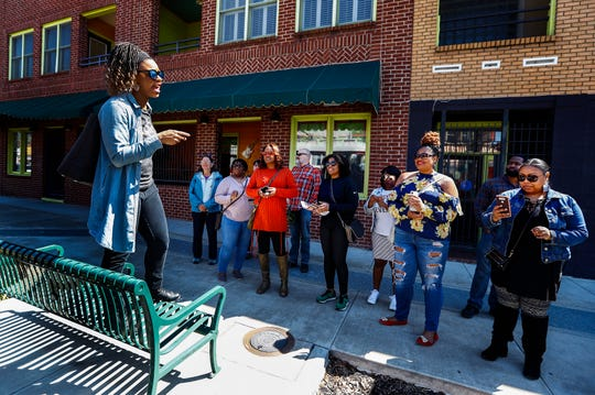 "City Tasting Tours owner Cristina McCarter, left, guides attendees down South Main Street during her ""Brunch So Hard"" food tour."