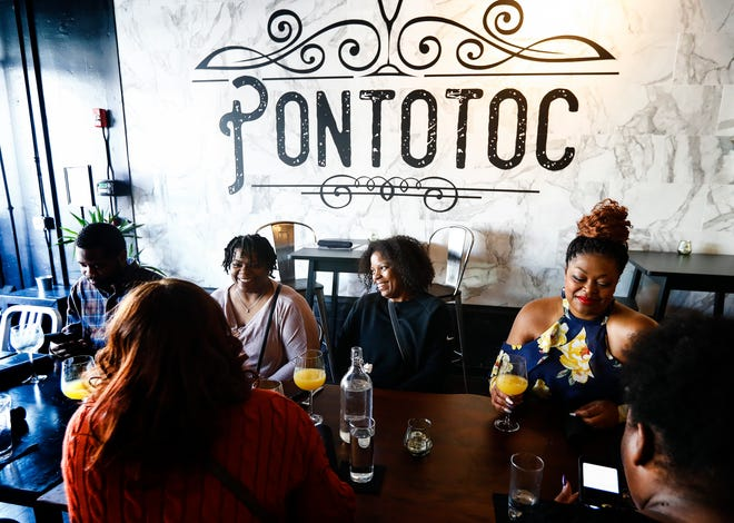 "Attendees of the City Tasting Tours' ""Brunch So Hard"" food tour enjoy themselves during a spot at Pontotoc on South Main. Pontotoc will participate in Downtown Dining Week this year."