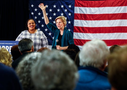 Democratic 2020 presidential hopeful Sen. Elizabeth Warren waves to supporters as Shelby County Commissioner Tami Sawyer (left) looks on during a campaign stop at Douglass High, on Sunday afternoon.