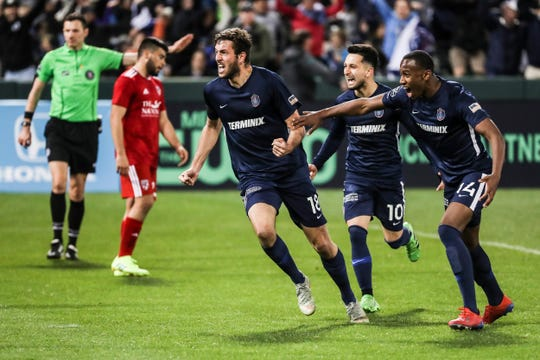 March 16, 2019 - Forward Elliot Collier, left, celebrates with teammates after scoring a goal in the 78th minute of Saturday night's game versus Loudoun United at AutoZone Park.