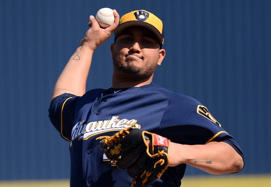 Feb 27, 2019; Phoenix, AZ, USA; Milwaukee Brewers starting pitcher Jhoulys Chacin (45) pitches against the Cleveland Indians during the first inning at Maryvale Baseball Park. Mandatory Credit: Joe Camporeale-USA TODAY Sports