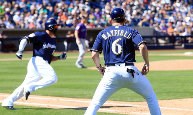 Cleveland Browns quarterback Baker Mayfield gives the Brewers' Mike Moustakas the green light on his way  to a double Saturday.