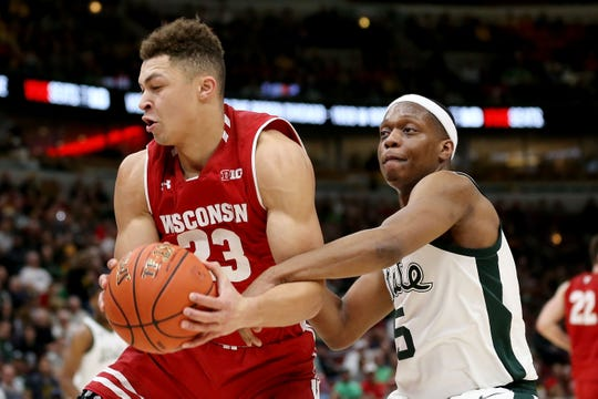 Wisconsin guard Kobe King gets hacked across the forearm by Michigan State's Cassius Winston at last year's Big Ten Tournament.