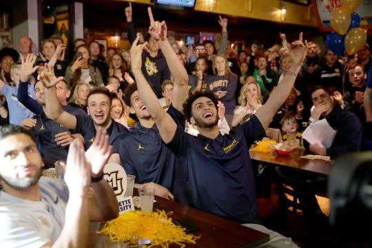 Marquette's Markus Howard and teammates cheer as they are shown on national TV before the announcement. The Marquette University men's basketball team held a viewing party for the NCAA Tournament selection show at the Marquette University Union Sports Annex  in Milwaukee on Sunday, March 17, 2019.