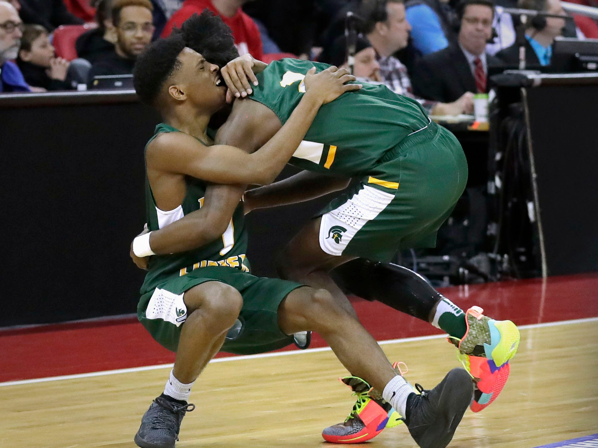 Martin Luther's Trequan Carrington and Ace Evans celebrate the Spartans' victory over Waupun in the Division 3 title game Saturday.
