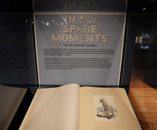 """Harold Schmitz made sketches of people and places he saw while serving in the Pacific with an Army map-making unit during World War II. He carefully preserved his drawings in an album discovered by his daughter a few years before his death in 2013. She donated the scrapbook to the Wisconsin Veterans Museum in Madison, which created a temporary exhibit, """"In My Spare Moments: The Art of Harold F. Schmitz."""""""
