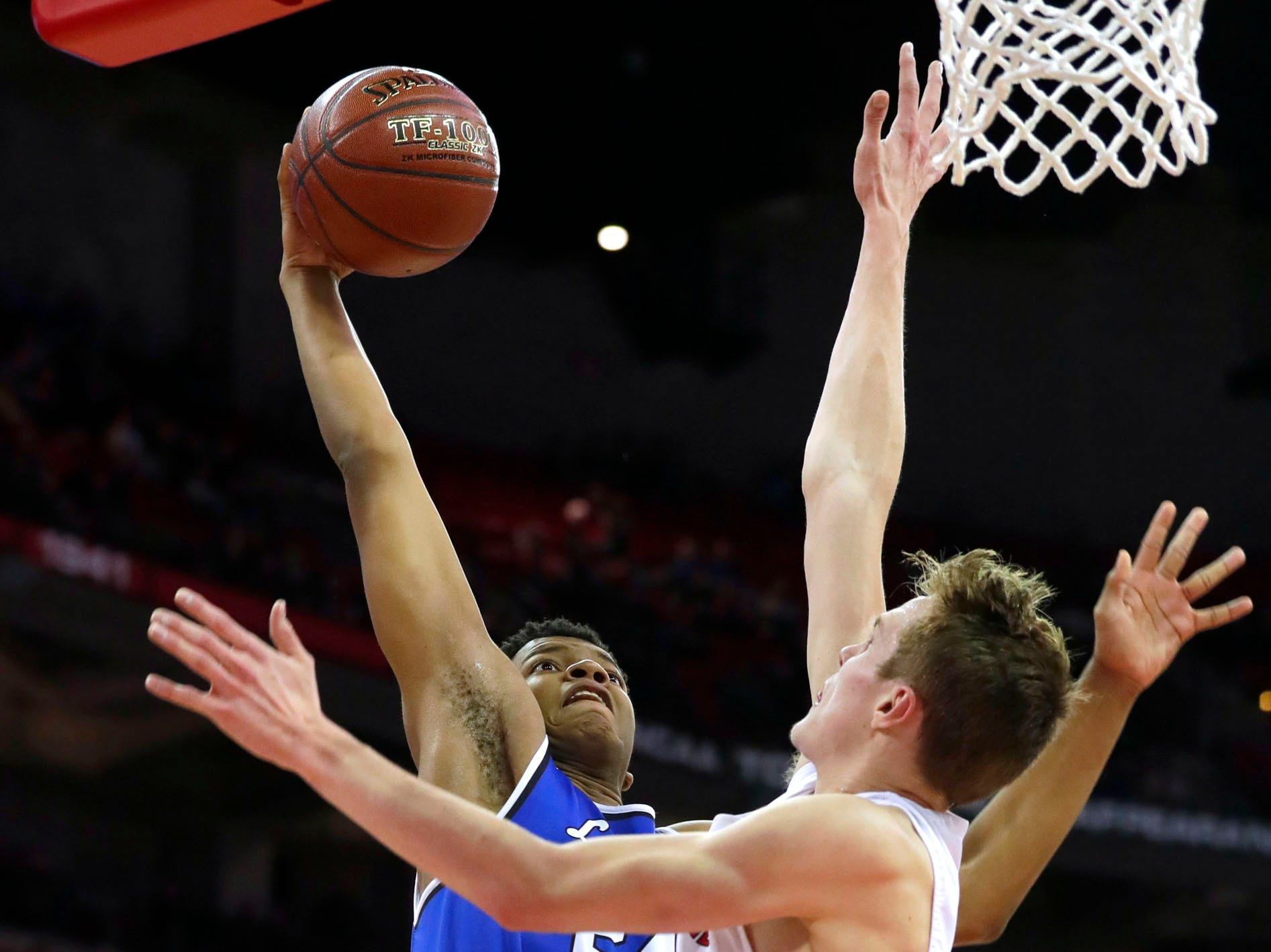Brookfield Central's David Joplin drives to the basket against Sun Prairie's Brock Voigt during the Division 1 championship game at the WIAA boys basketball state tournament in Madison on Saturday, March 16, 2019.