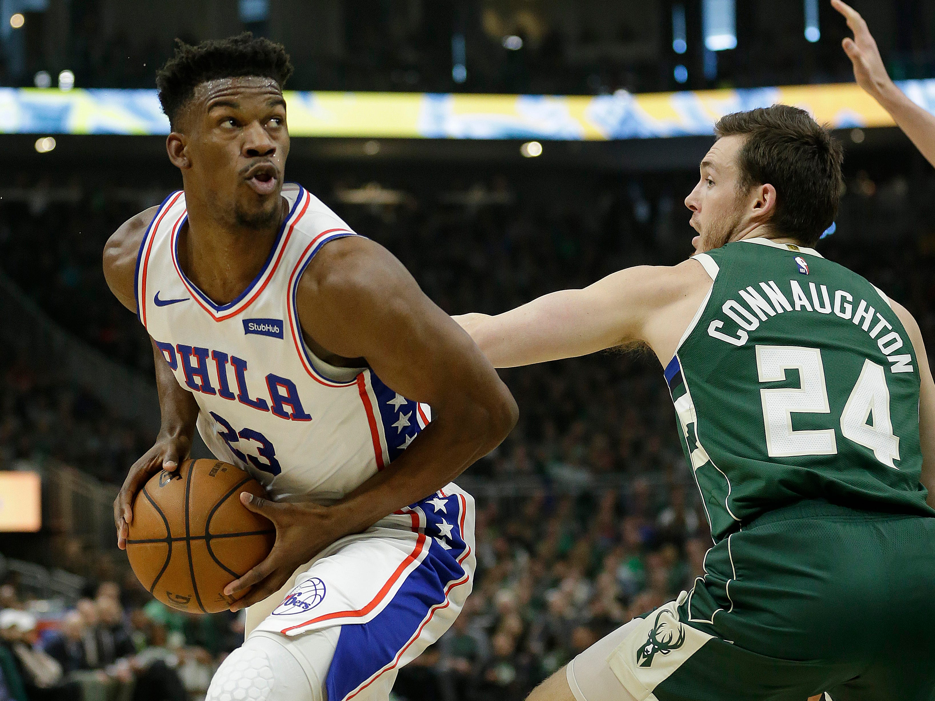 Former Marquette standout Jimmy Butler of the 76ers looks to shoot against Bucks guard Pat Connaughton during the first half. Butler finished with 27 points in Philadelphia's victory.