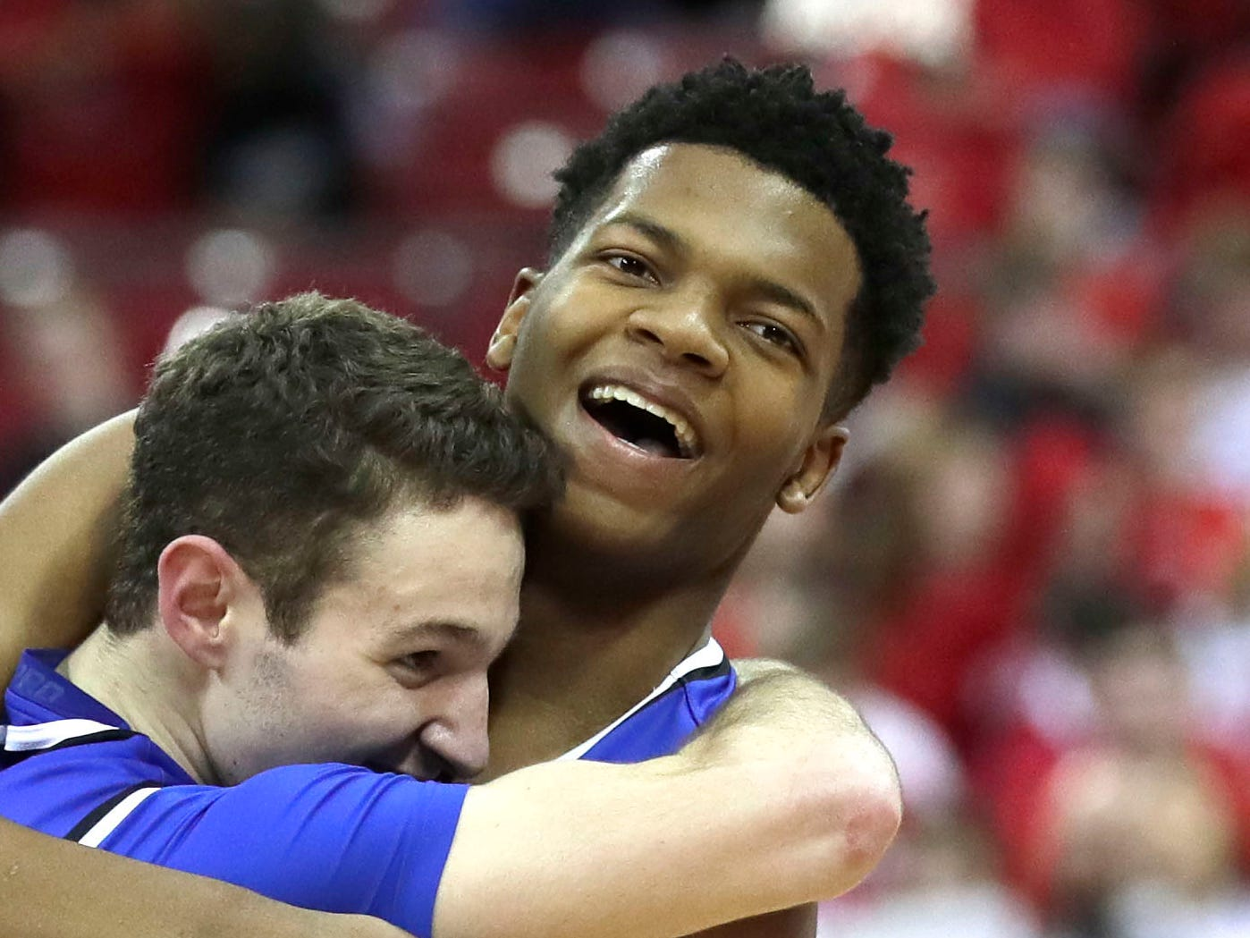 David Joplin (right) hugs teammate Cole Nau as they celebrate Brookfield Central's 69-52 victory over Sun Prairie in the WIAA Division 1 state championship game Saturday, March 16, at the Kohl Center in Madison.