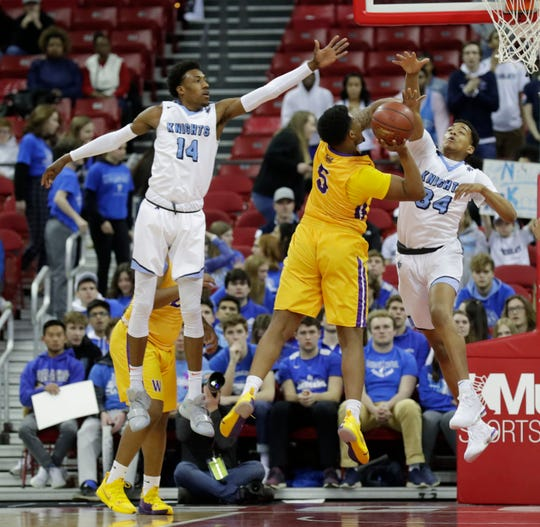 Milwaukee Washington's Deontay Long tries to shoot past Nicolet's Jamari Sibley and James Graham Milwaukee  during the Division 2 championship game at the WIAA 2019 boys basketball state tournament in Madison, Wisconsin, Saturday, March 16, 2019.  Rick Wood/Milwaukee Journal Sentinel
