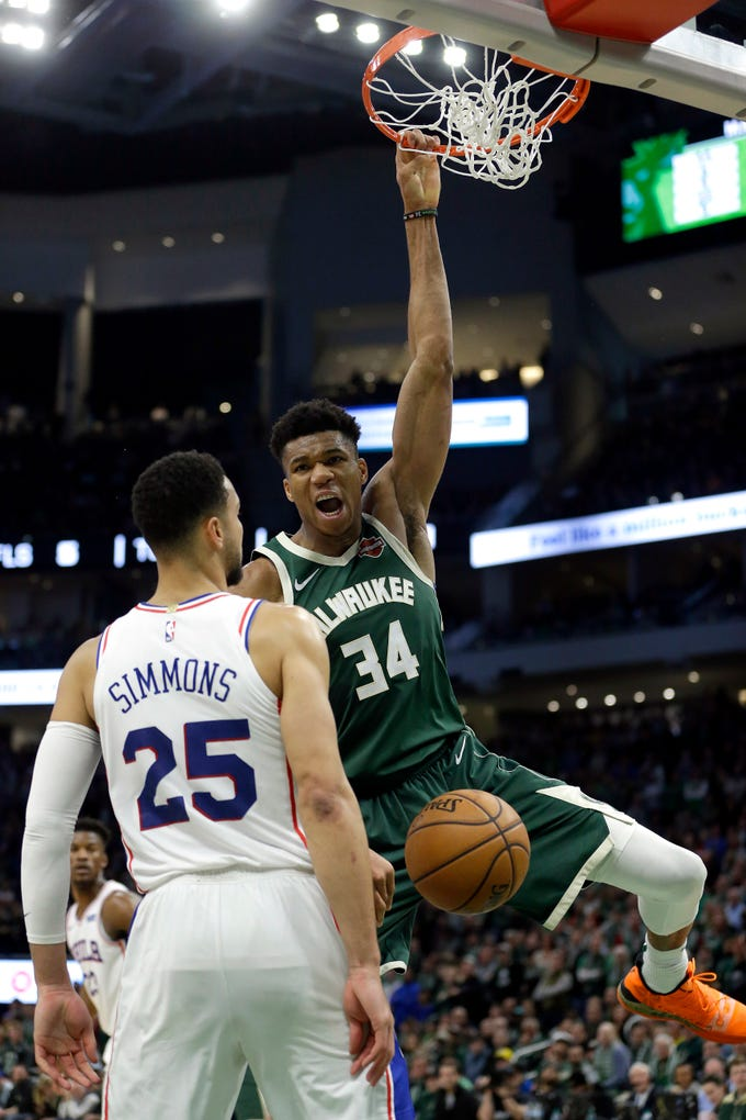 Giannis Antetokounmpo of the Bucks lets out a howl directed at Ben Simmons after dunking on the 76ers guard while being fouled late in the fourth quarter Sunday at Fiserv Forum.