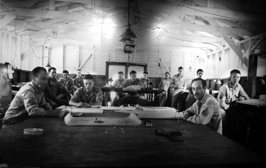 Soldiers in the Army's 955th Topographic Engineer Co. making maps during World War II in the Pacific. Army mapmakers frequently updated maps after bombings and battles on islands throughout the Pacific.