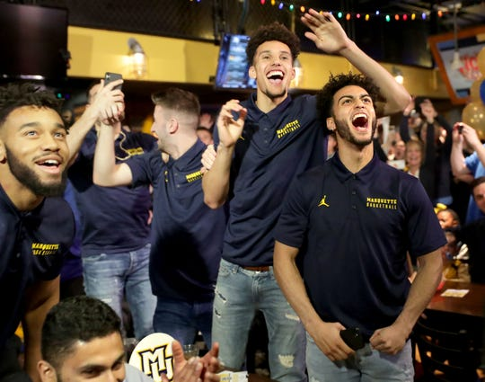 Markus Howard (far right) and teammate Brendan Bailey erupt in a cheer after learning the team's seeding (No. 5) and opponent (Murray State) during a NCAA Tournament selection show viewing party Sunday.