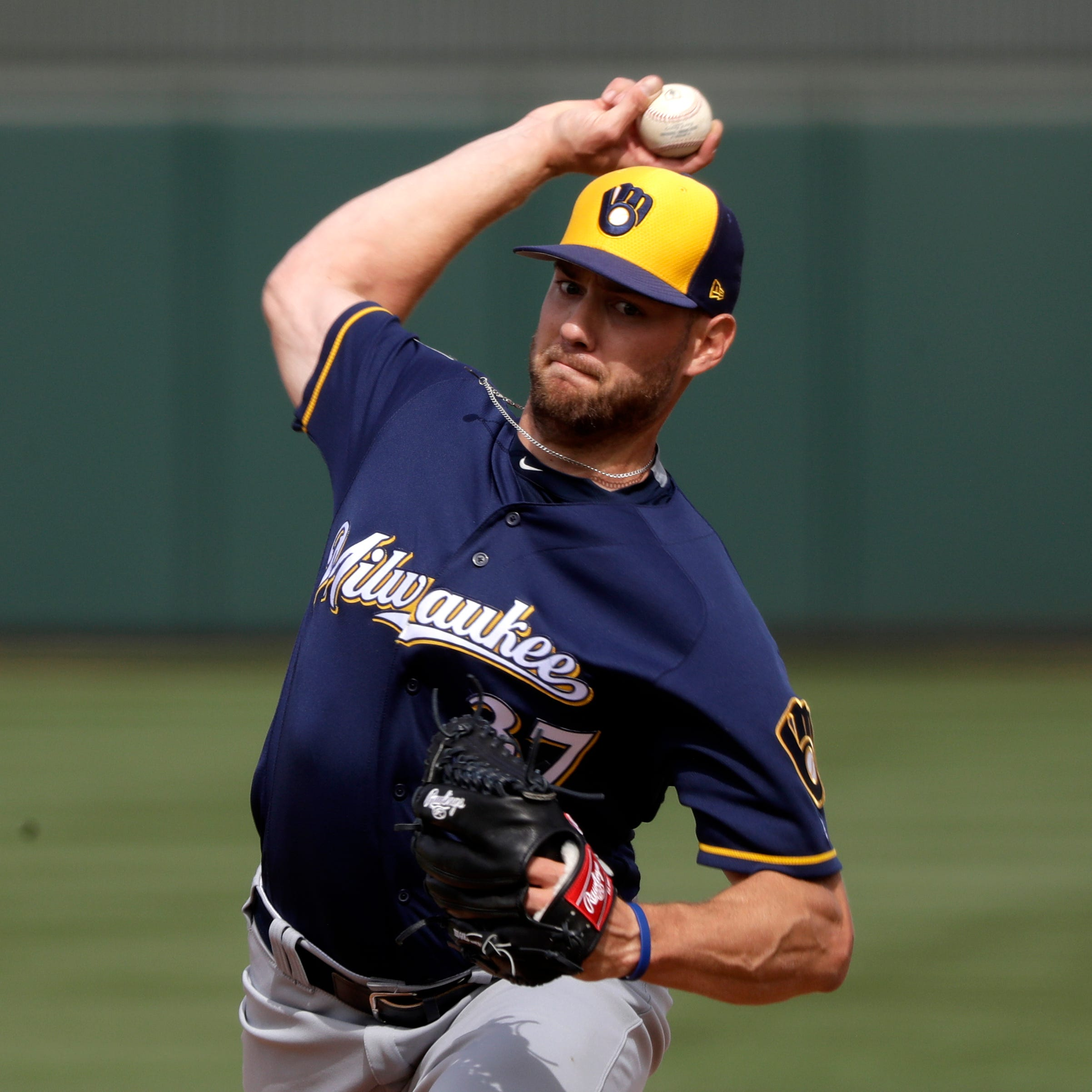 Adrian Houser, Jacob Nottingham among players sent to minor-league camp by Brewers
