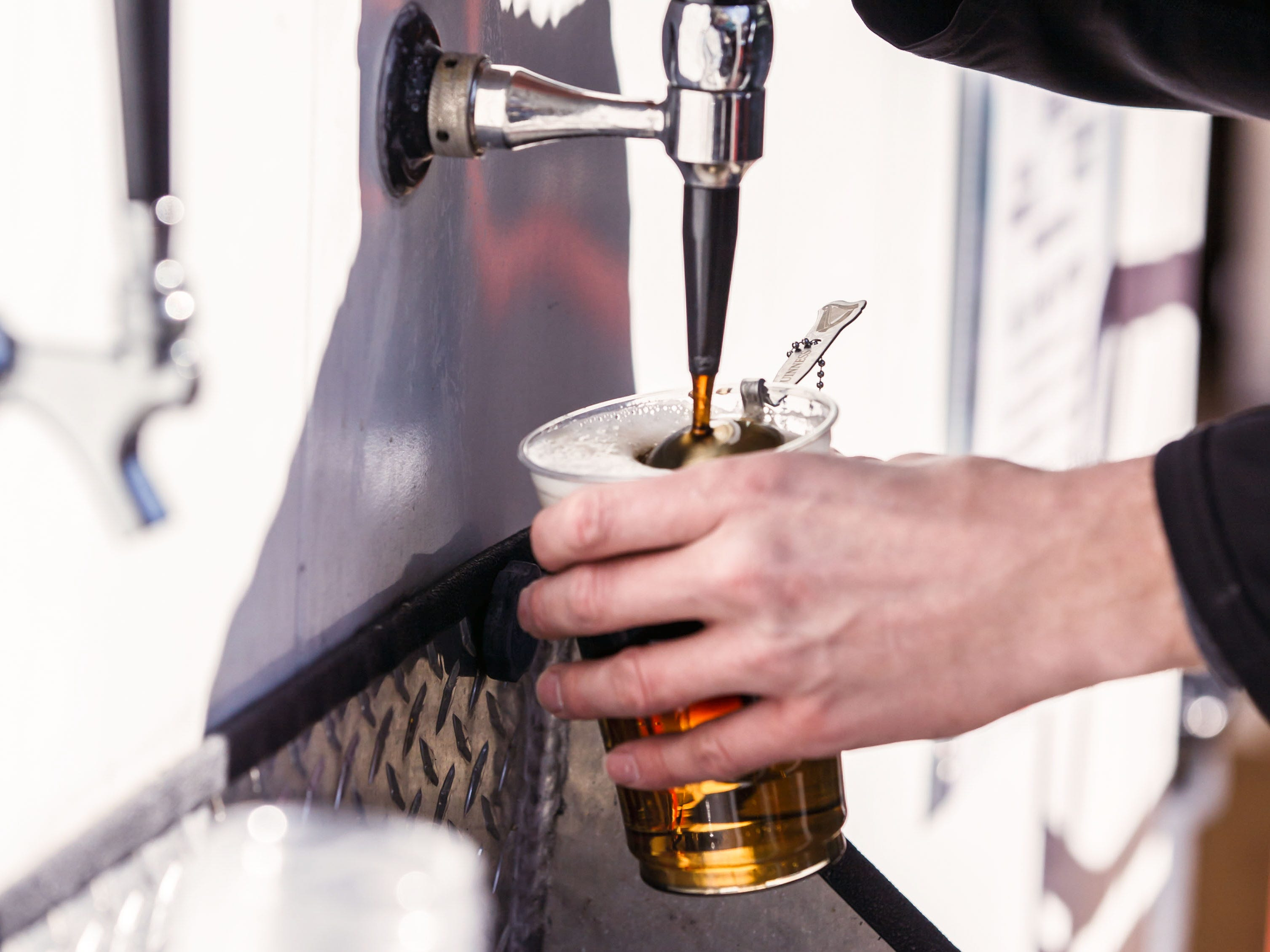 Three Lions Pub employee Dustin Uebelacker keeps the ale flowing during the Shorewood Shenanigans street festival on Saturday, March 16, 2019. The annual event on N. Oakland Ave. features live music, food and drink, games, vendors and more. Nine bars and restaurants along N. Oakland Ave. participate in the fun.