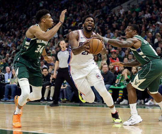 The Bucks' Giannis Antetokounmpo (left) and Eric Bledsoe were both named to the NBA all-defensive first team.