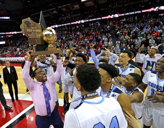 Nicolet celebrates its 67-54 win over Milwaukee Washington during the Division 2 state championship game on March 16, 2019.