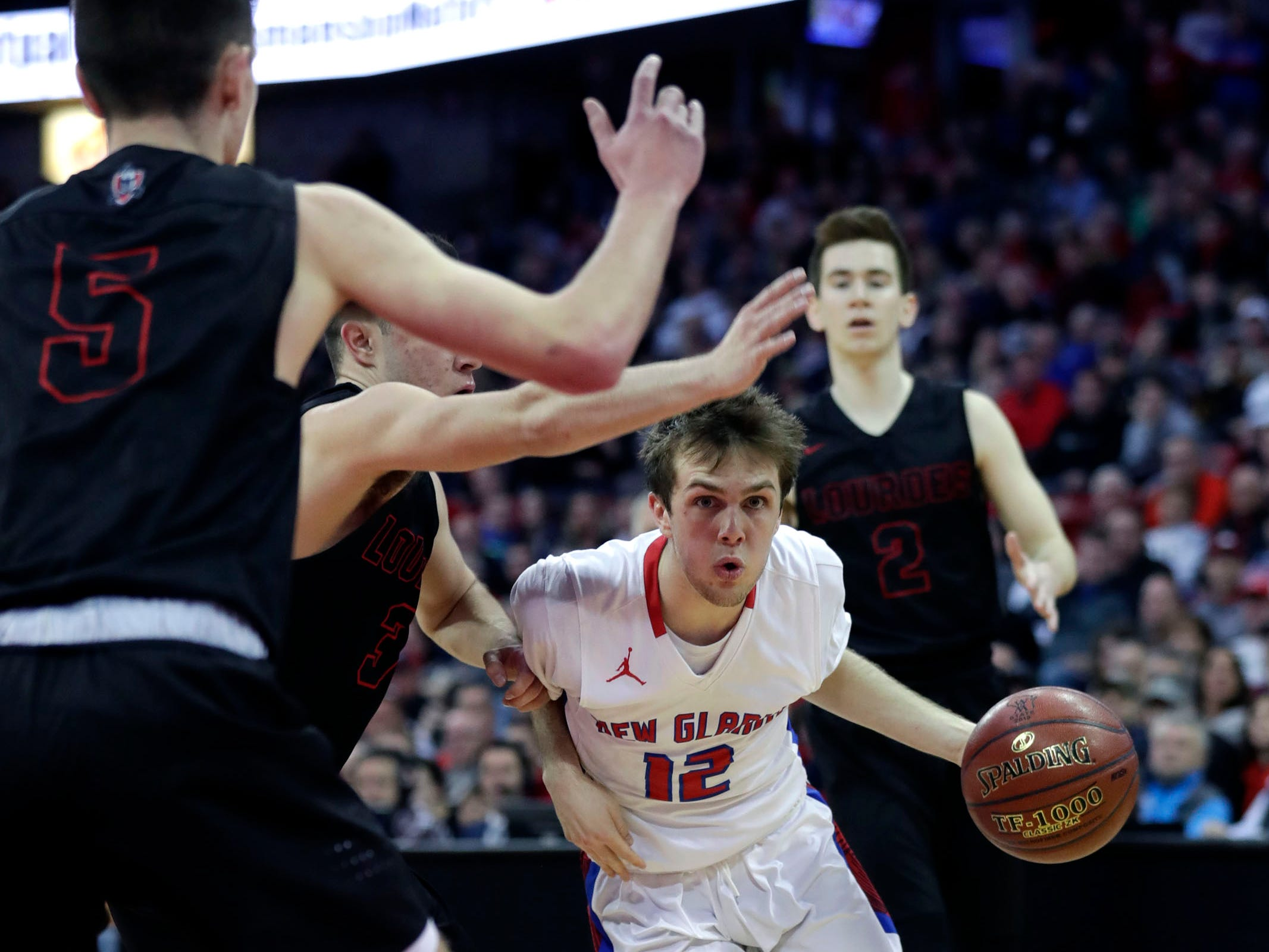 New Glarus's  Jaden Kreklow drives in for two of his game-high 22 points against Oshkosh Lourdes in the WIAA Division 4 title game.