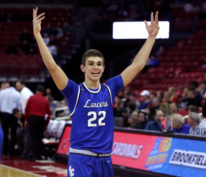 Ben Nau of Brookfield Central starts celebrating as the Lancers toppled Sun Prairie in the Division 1 title game Saturday.