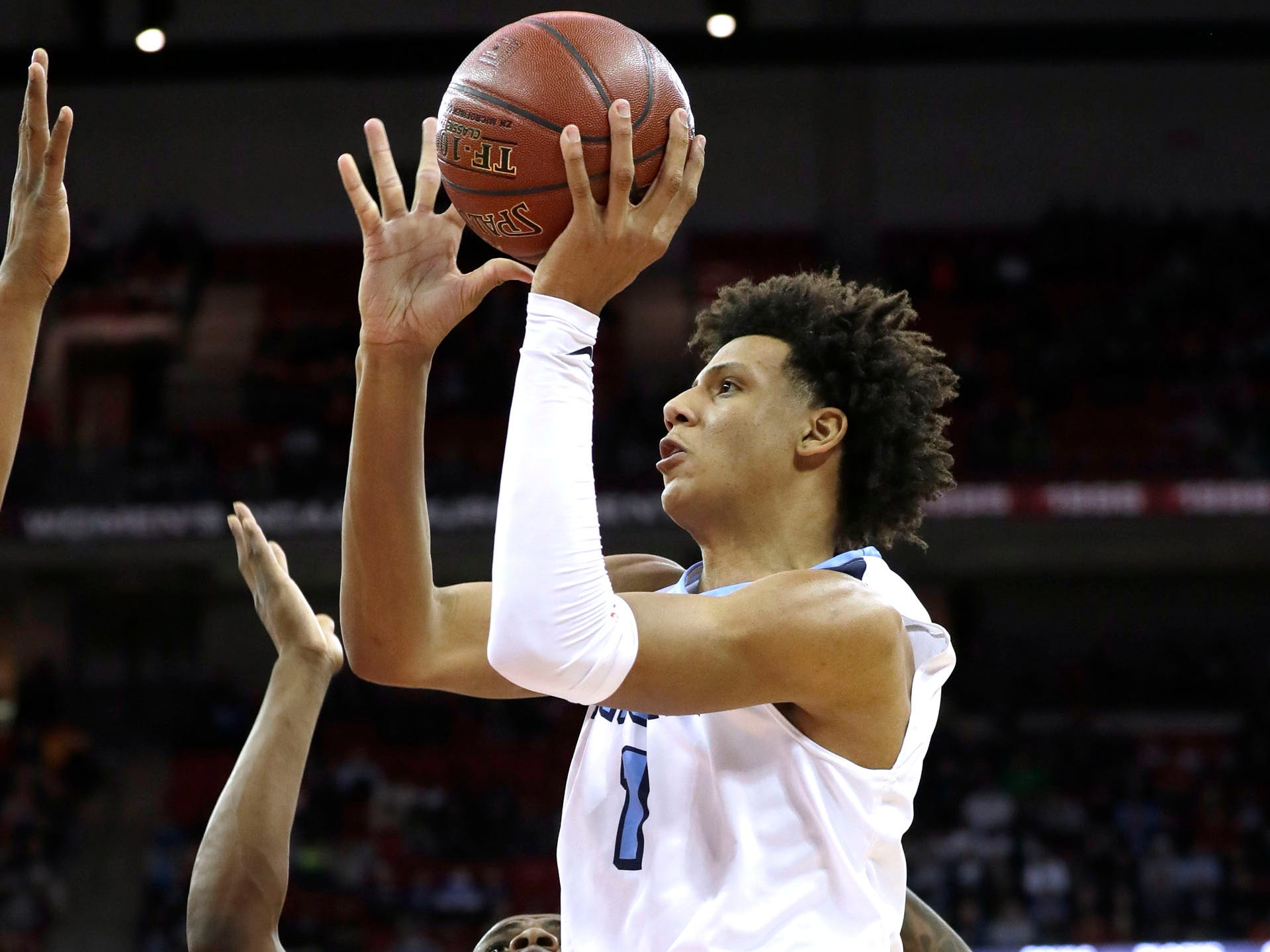 Nicolet's  Jalen Johnson drives to the basket for a shot against Washington on Saturday.