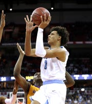 Nicolet's Jalen Johnson drives to the basket against Milwaukee Washington during the Division 2 championship game at the 2019 WIAA boys state basketball tournament in Madison on March 16.